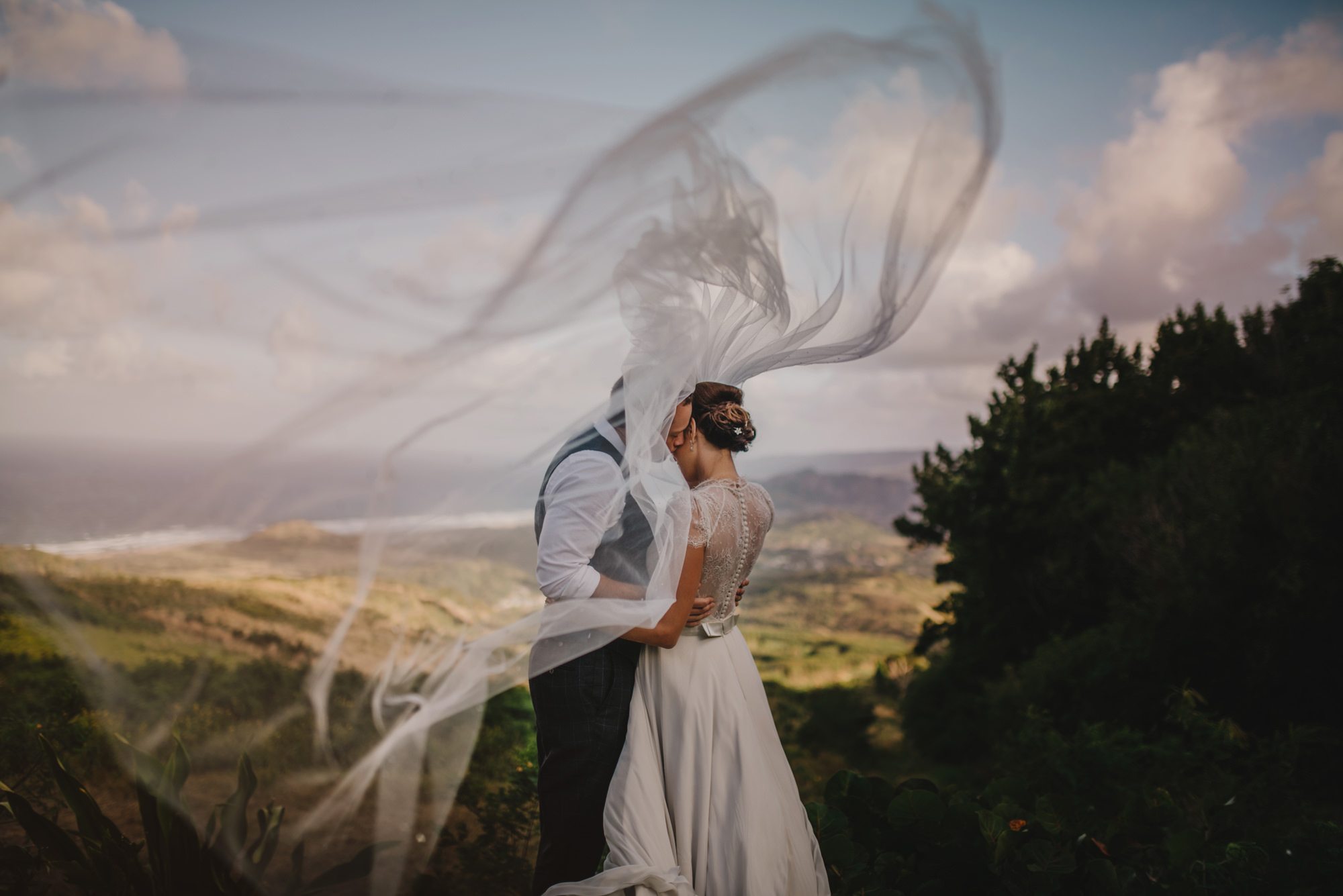 Veil billows during embrace - photo by McClintock Photography Agency