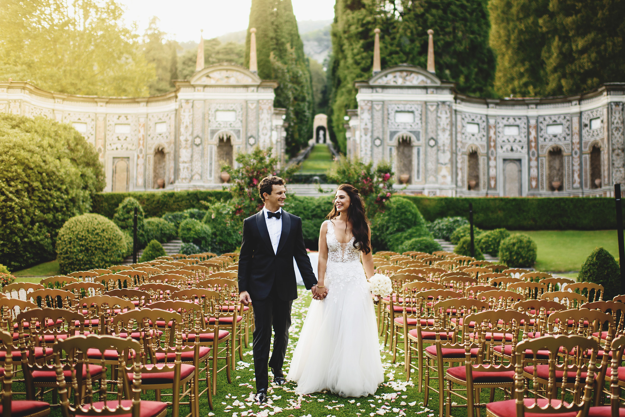 Couple walking isle at luxury Villa d'Este - photo by Ross Harvey