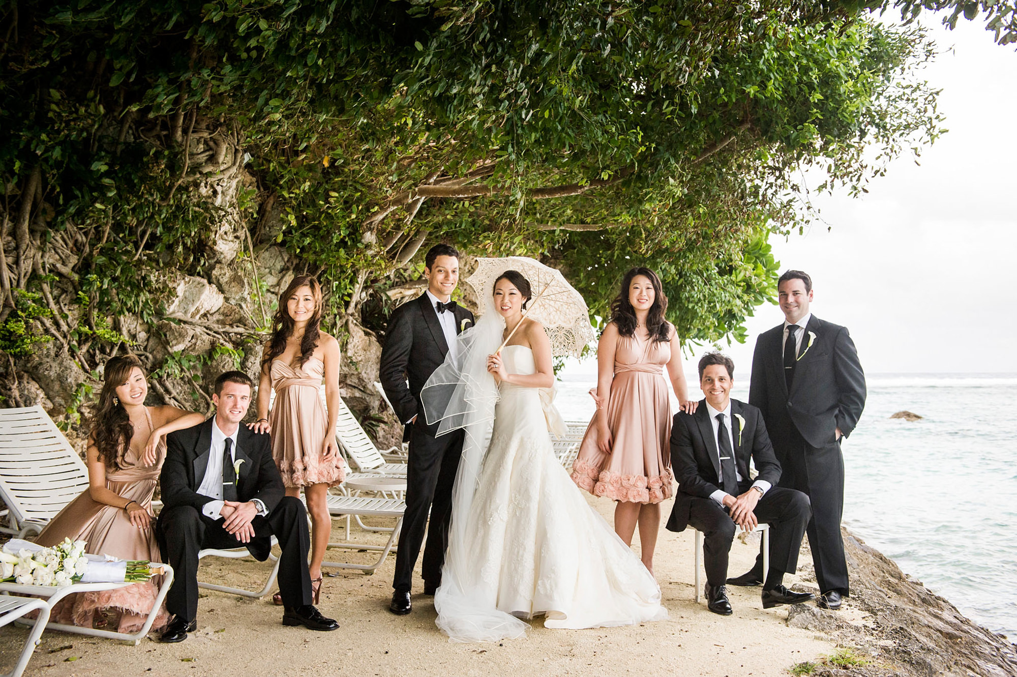 Wedding party bride with lace umbrella and pink bridesmaid dresses -  photo by Marcus Bell