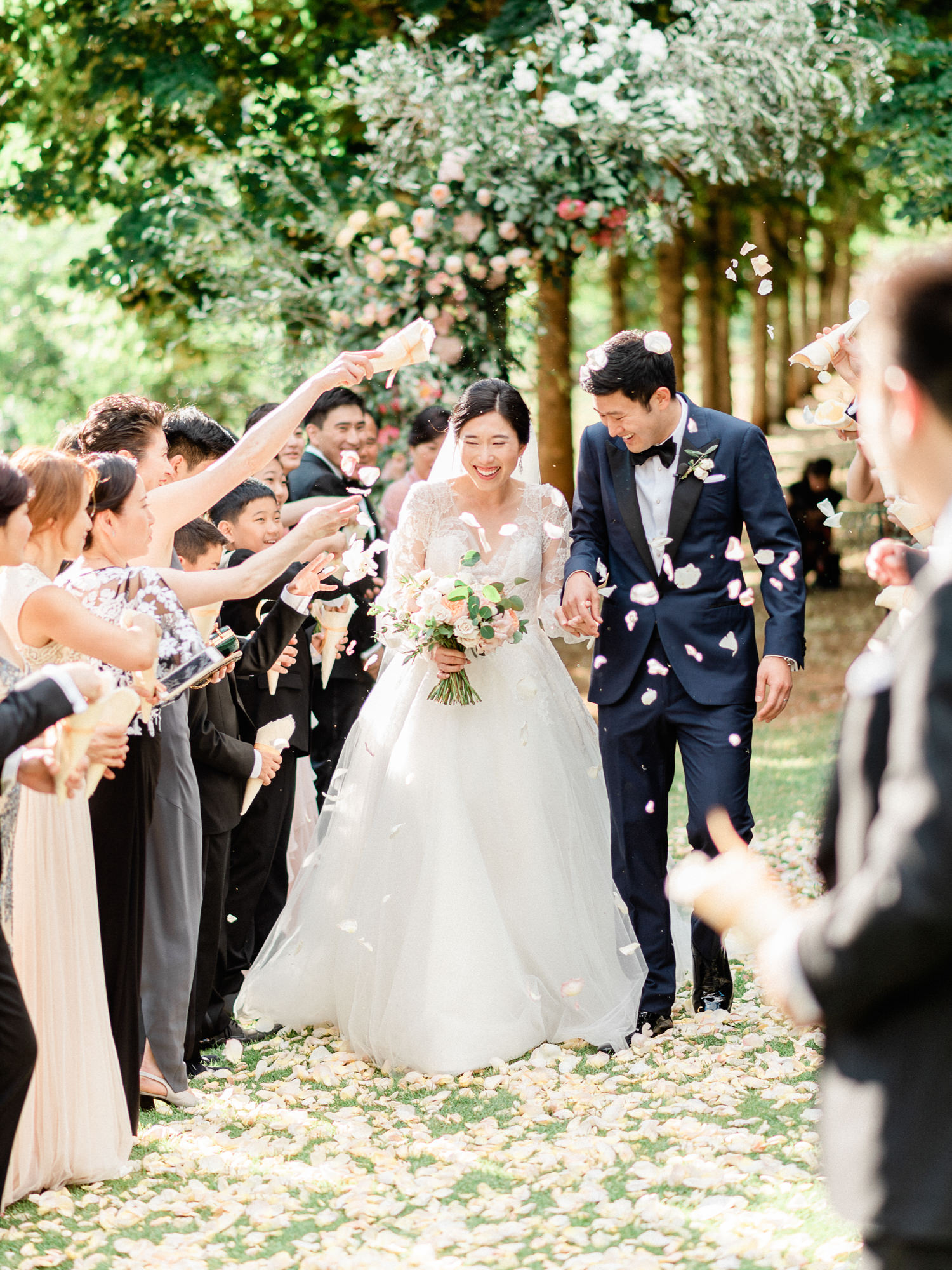 Happy couple leaving Villa Cimbrone ceremony by Gianluca Adovasio Photography