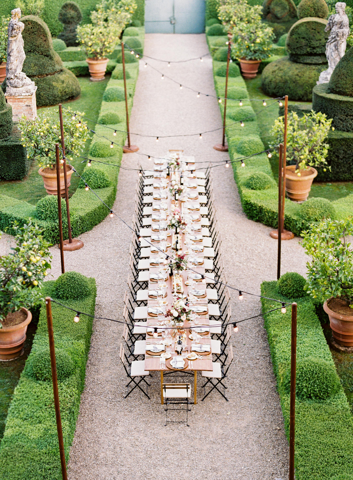 wedding banquet table for 30 in topiary garden Jen Huang Los Angeles wedding photographer.
