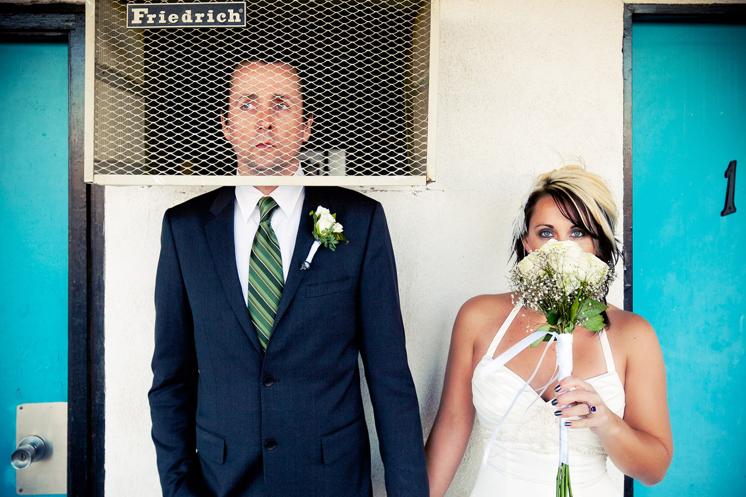 Silly portrait of groom in AC grille with bride hiding behind bouquet, by Callaway Gable