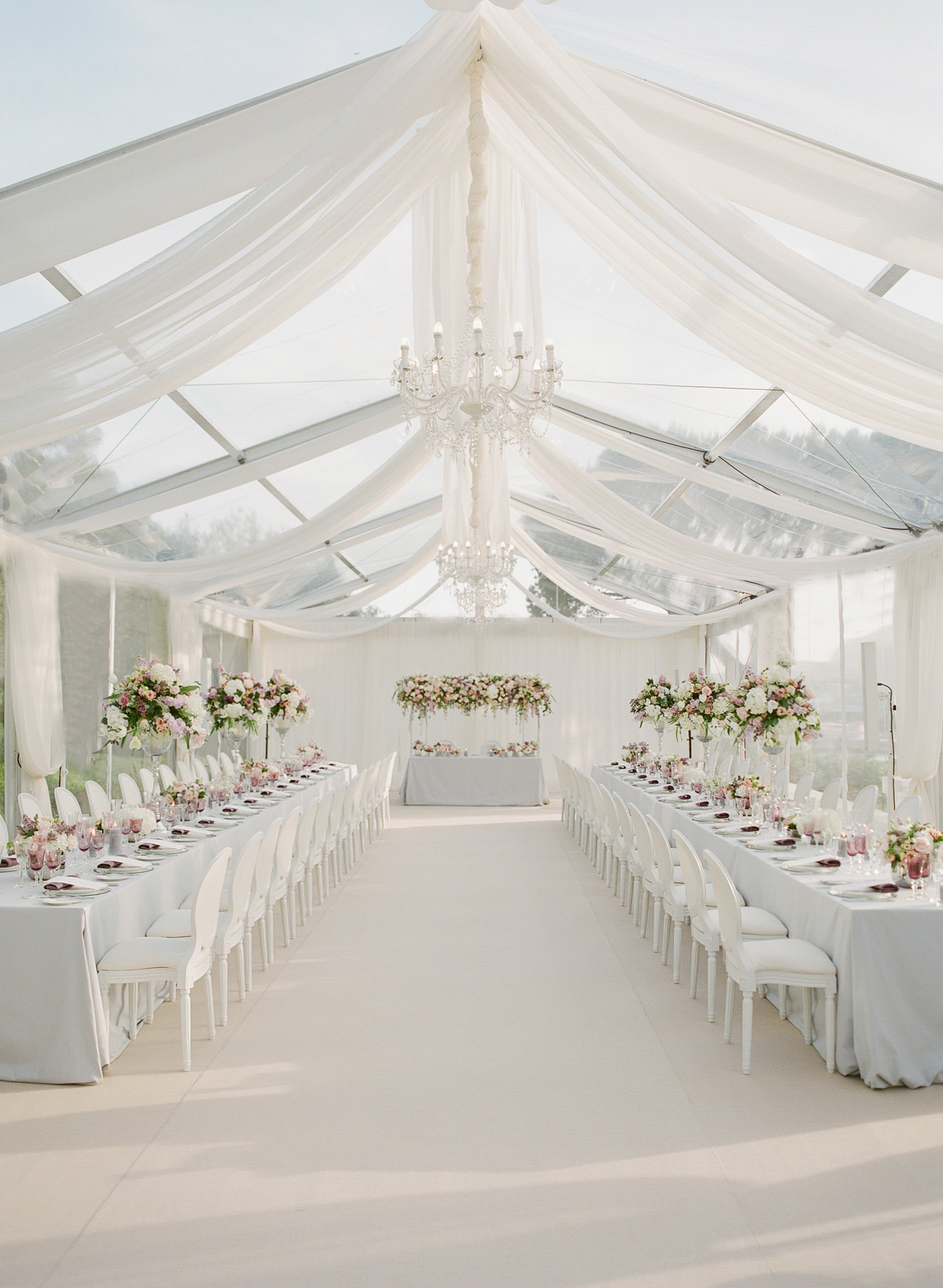 Chiffon tented wedding reception with opera chairs - Greg Finck Photography
