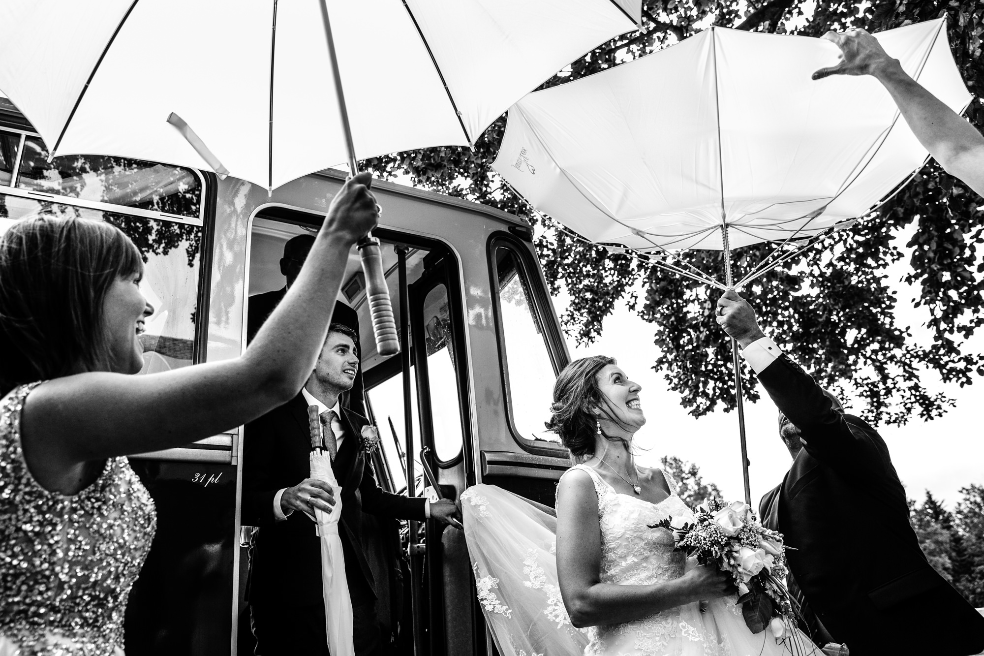 White umbrellas turned inside out, black and white photo by Yves Schepers, Belgium wedding photographers