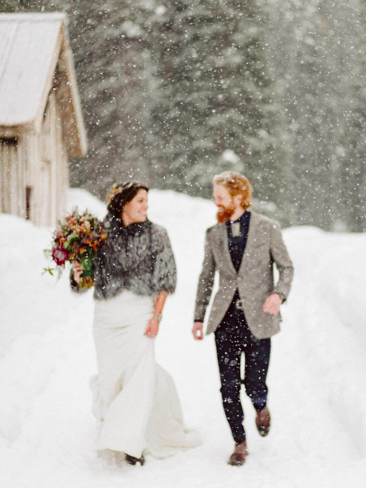 Couple running in snow - Photo by Benj Haisch - Seattle