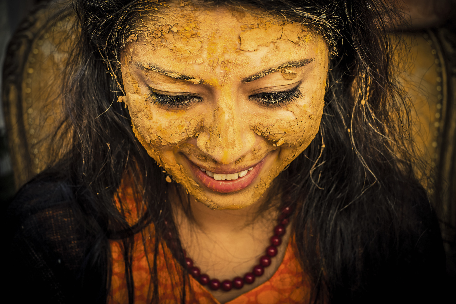 Indian woman caked with saffron - photo by Sephi Bergerson