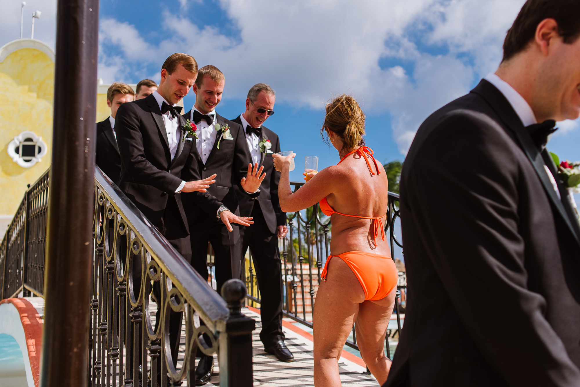 Groomsmen turning down drinks from bikini gal, by Citlalli Rico