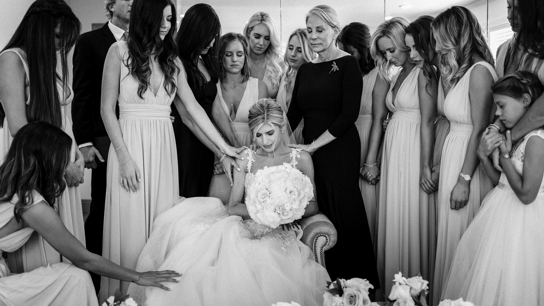 Women praying with bride - photo by John and Joseph - Los Angeles