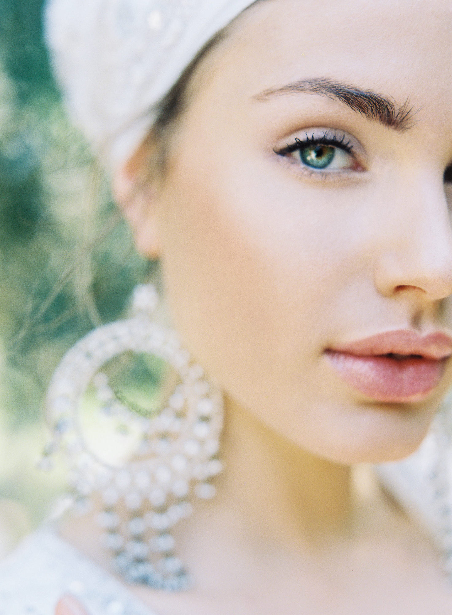 Bride with Indian chandelier earrings blush makeup Jen Huang Los Angeles wedding photographer