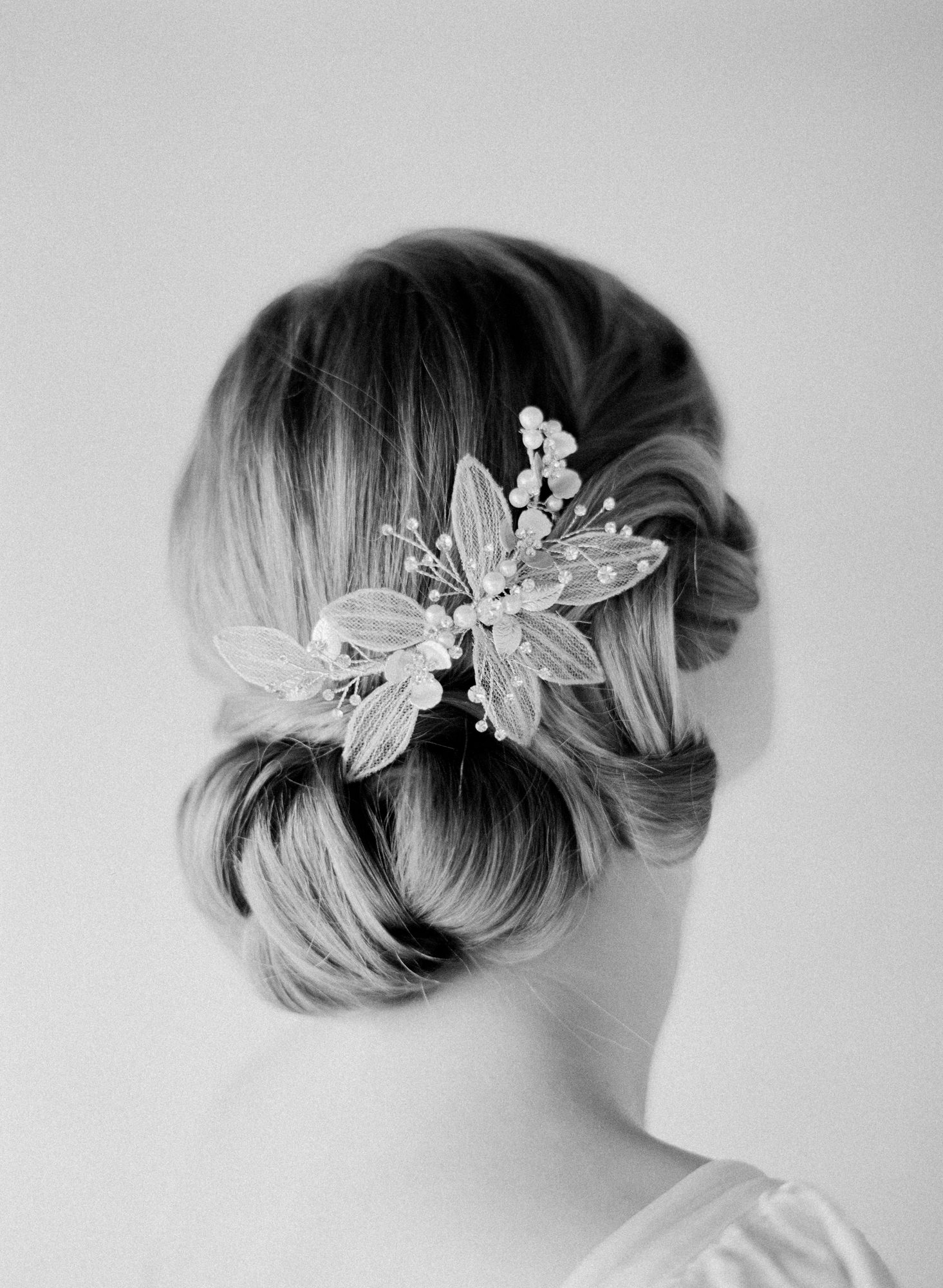 Classic chignon lace floral hair accessory Jen Huang Los Angeles wedding photographer