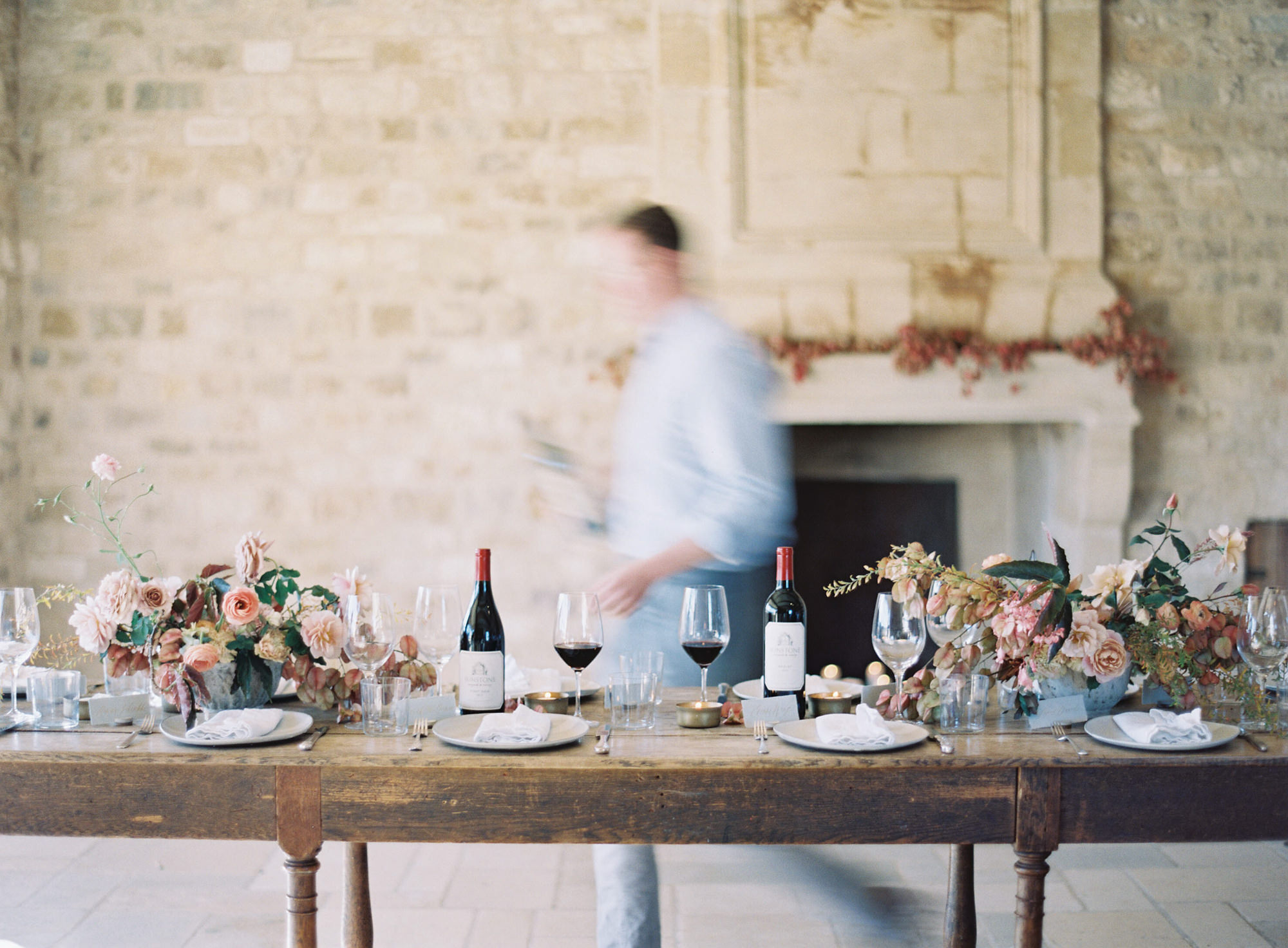 Rustic tablescape with floral decor and wine Jen Huang Los Angeles wedding photographer