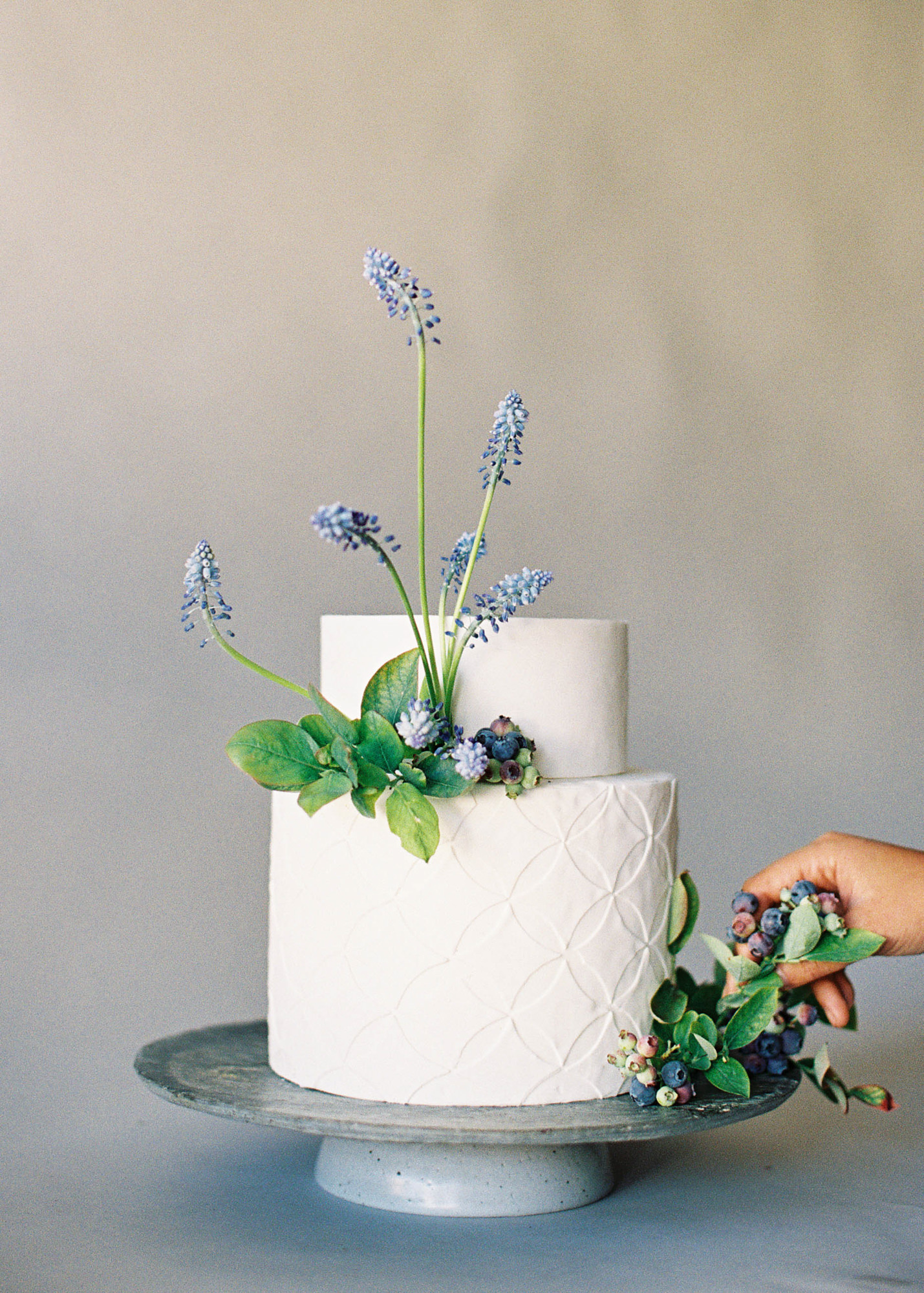 white fondant cake hyancinth blueberries Jen Huang Los Angeles wedding photographer