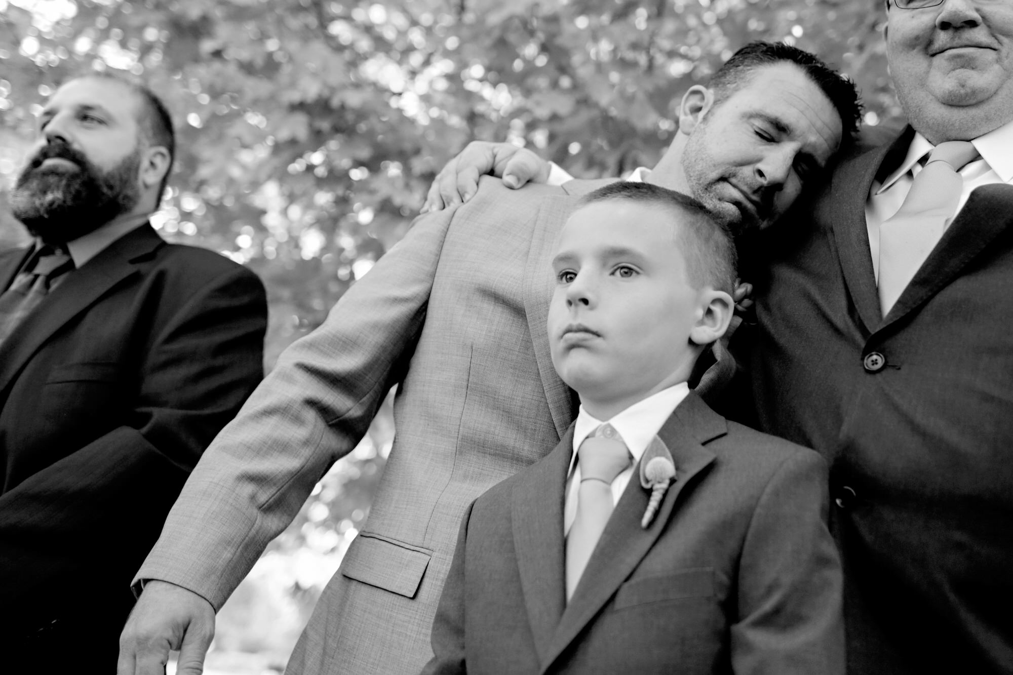 Emotional groom leans on father - Photo by Tyler Wirken - Missouri