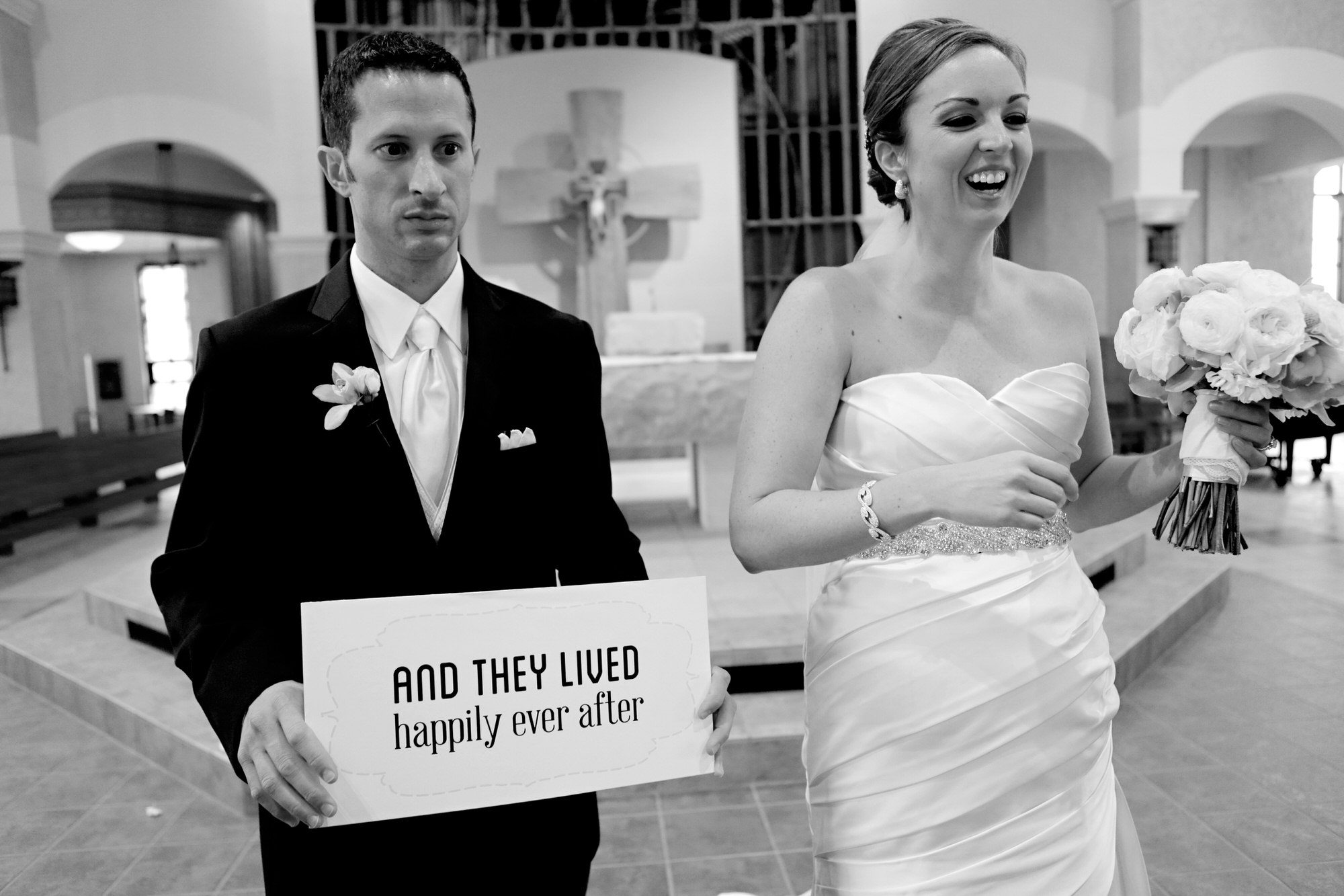 Funny photo of couple with happily ever after sign - Photo by Tyler Wirken - Kansas City