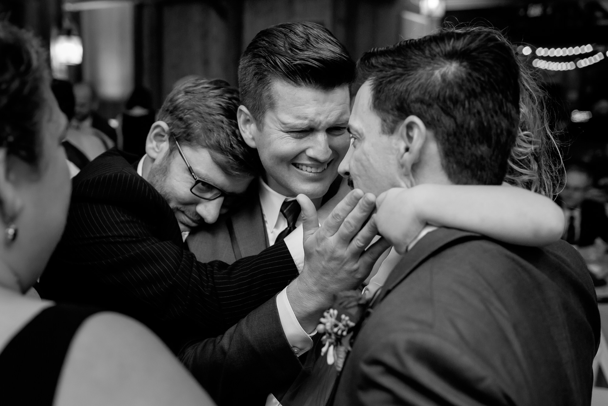 Moment with groomsmen hugging photo by Tyler Wirken - Kansas City