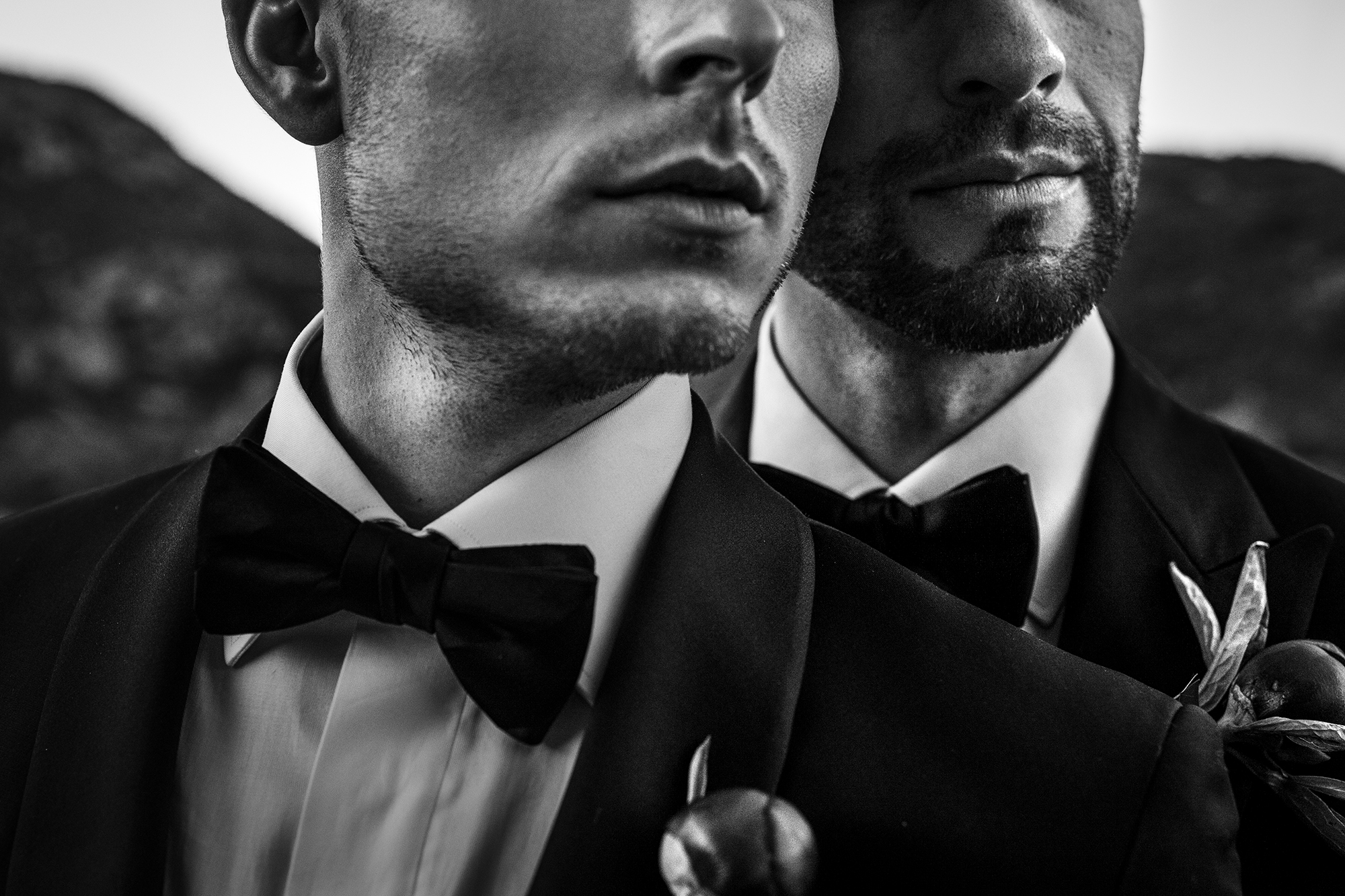 Two grooms in tuxes - photo by Victor Lax