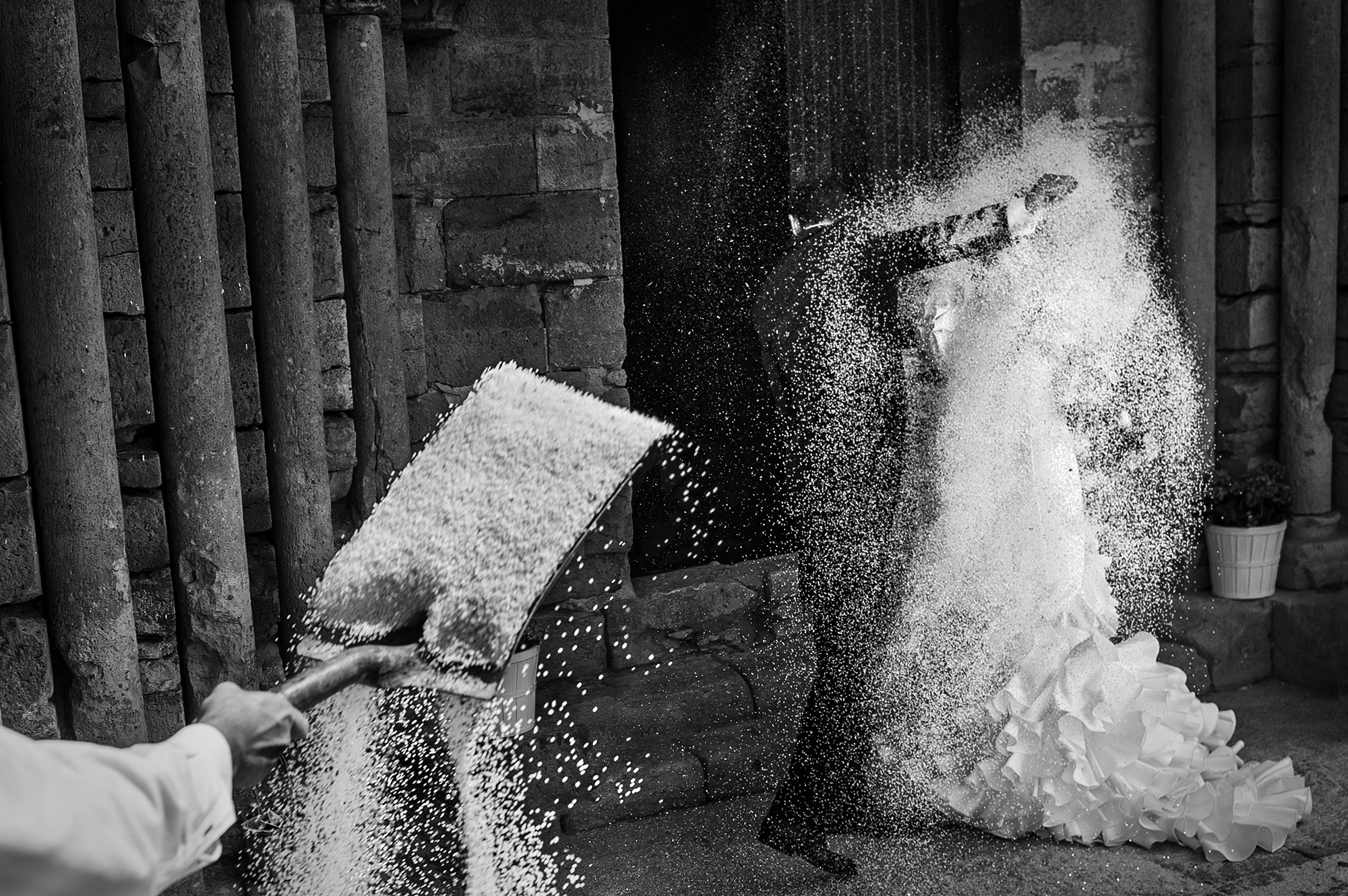 Shoveling rice on bride and groom - photo by Victor Lax