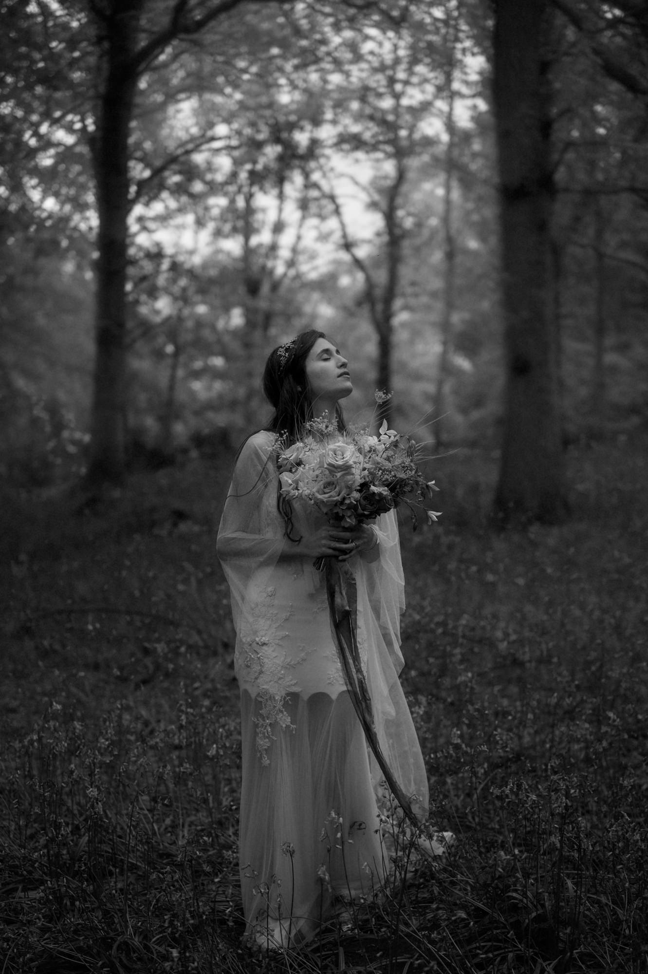 Black and white portrait of bride in forest - photo by the Kitcheners - Scotland