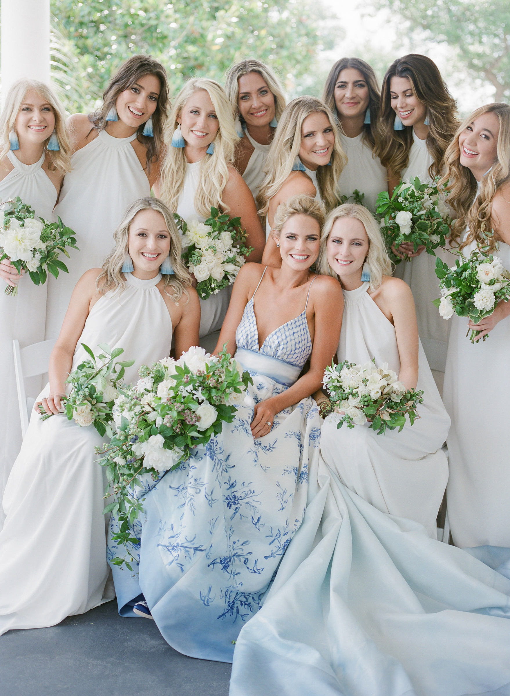 Bridal party in halter gowns and bride in strapless floral dress - photo by Corbin Gurkin
