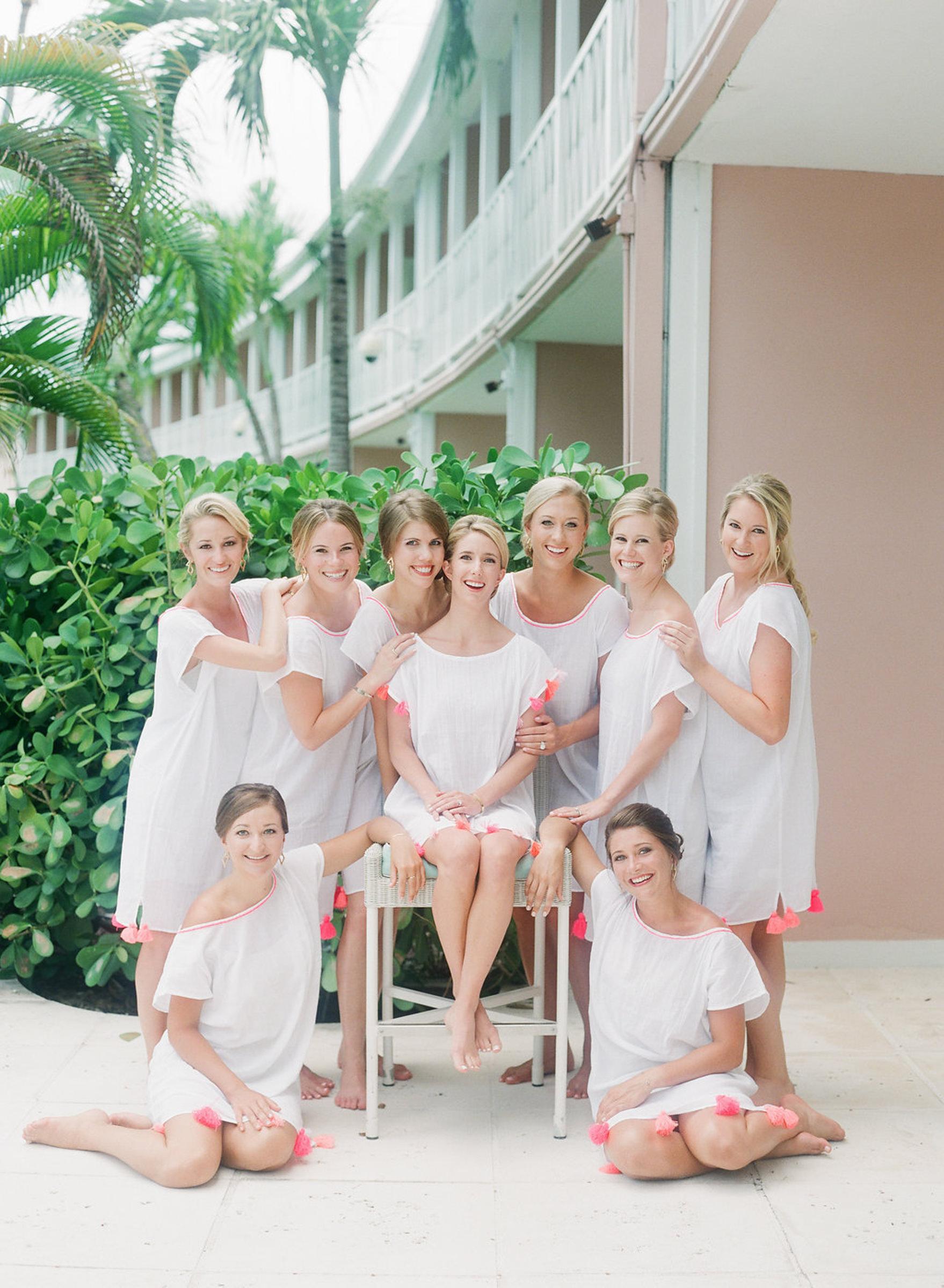 Group portrait of bridesmaid in pool attire by Corbin Gurkin