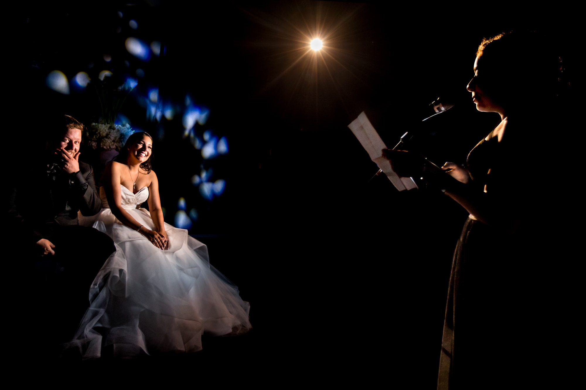 Couple laughing during toast by Two Mann Studios