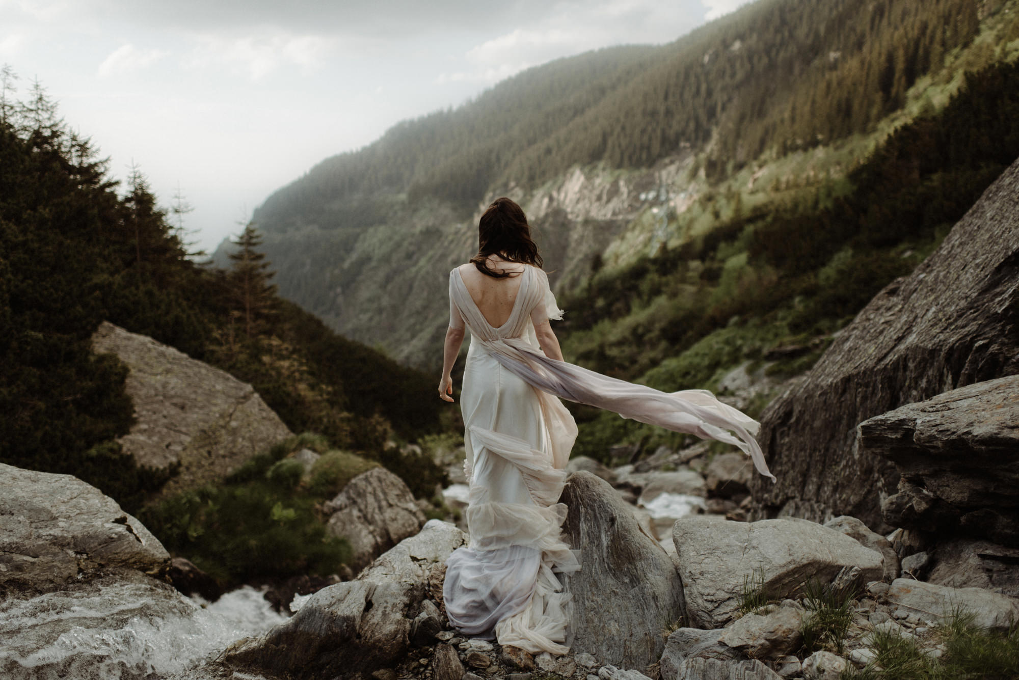 Bride in flowing chiffon dress at waterfall - photo by the Kitcheners - Scotland