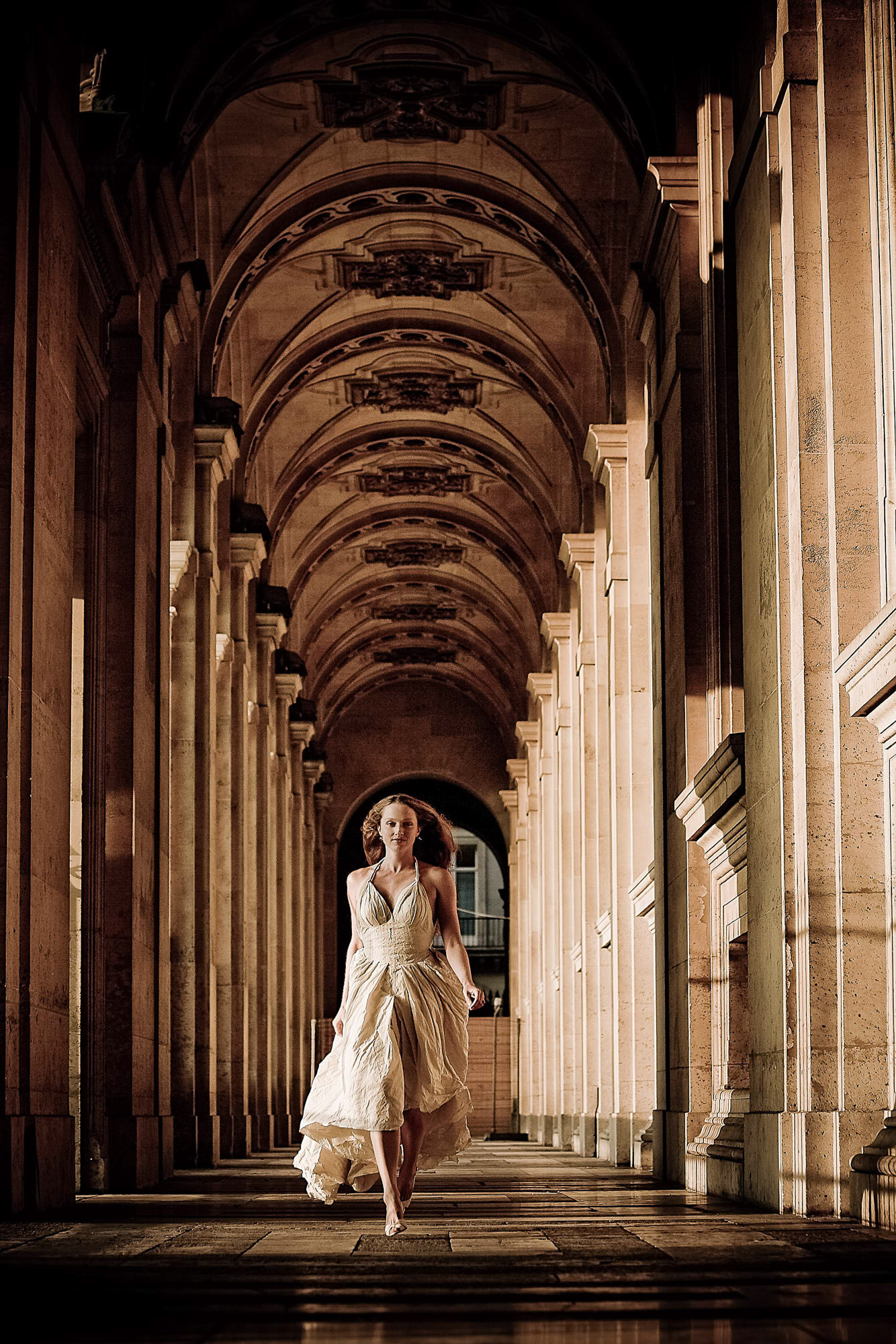 Bride in flowing gown walking through columns photo by JOS Studios : Jos and Tree Woodsmith