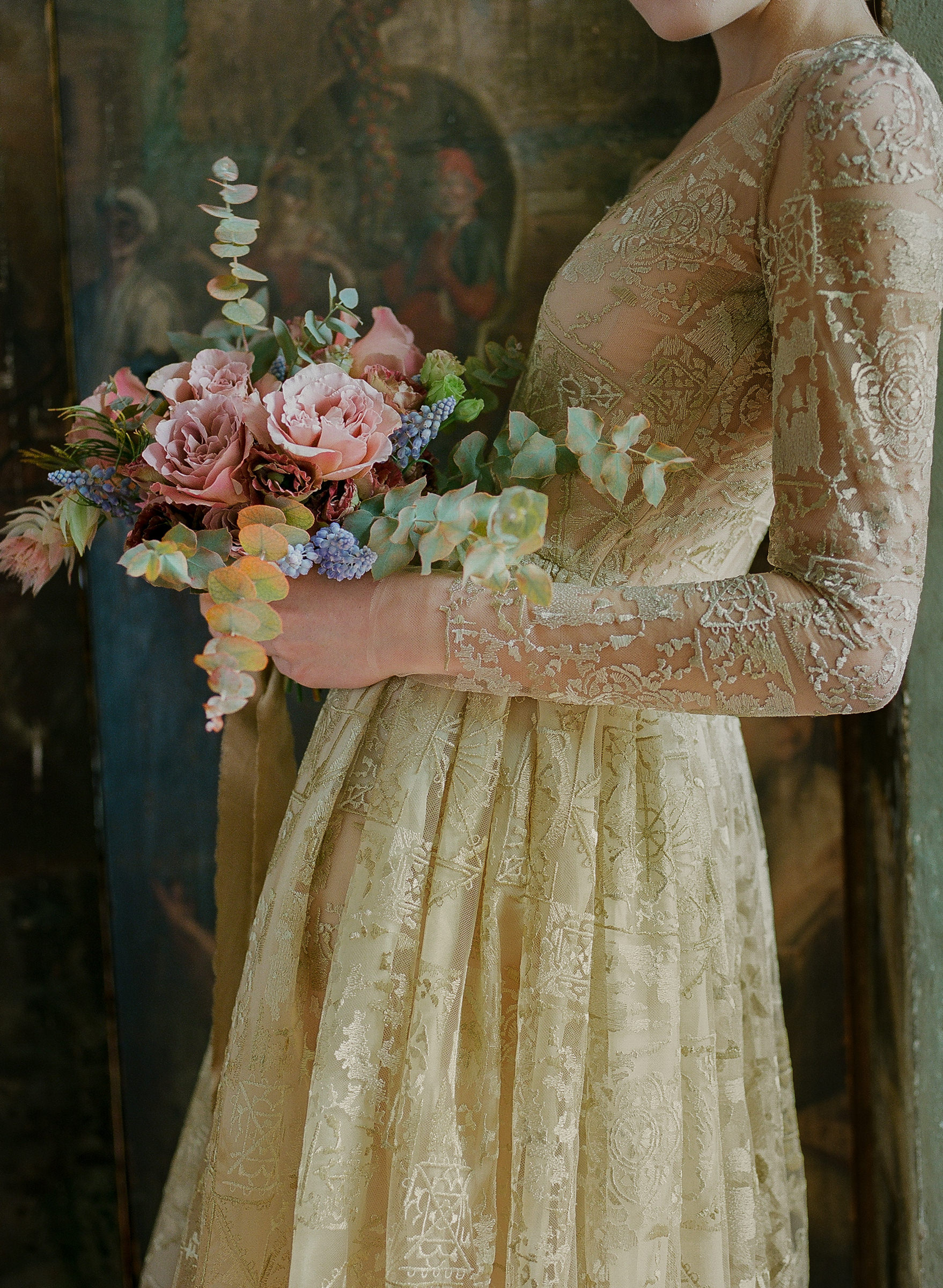 Bride in metallic lace gown with antique rose bouqet by Corbin Gurkin