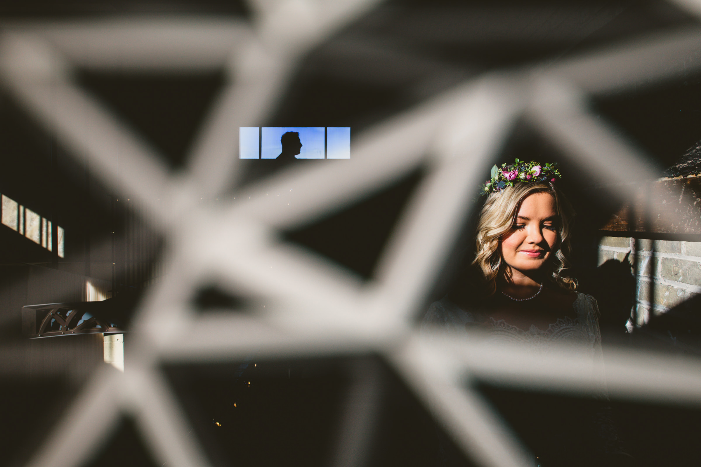 Bride photographed through metal geometric fence - photo by Sam Hurd - DC