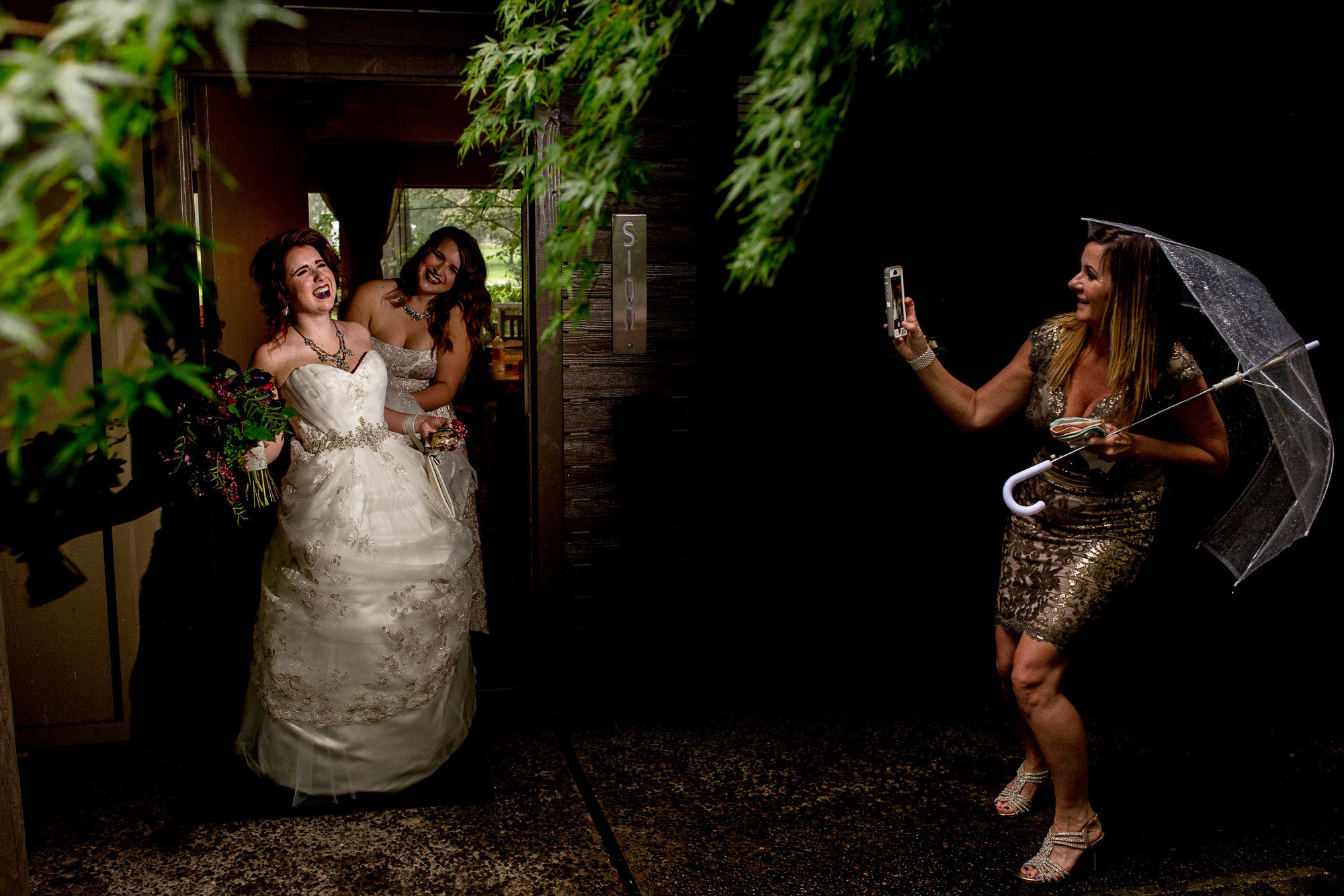 Bride shows off dress photo by JOS Studios : Jos and Tree Woodsmith