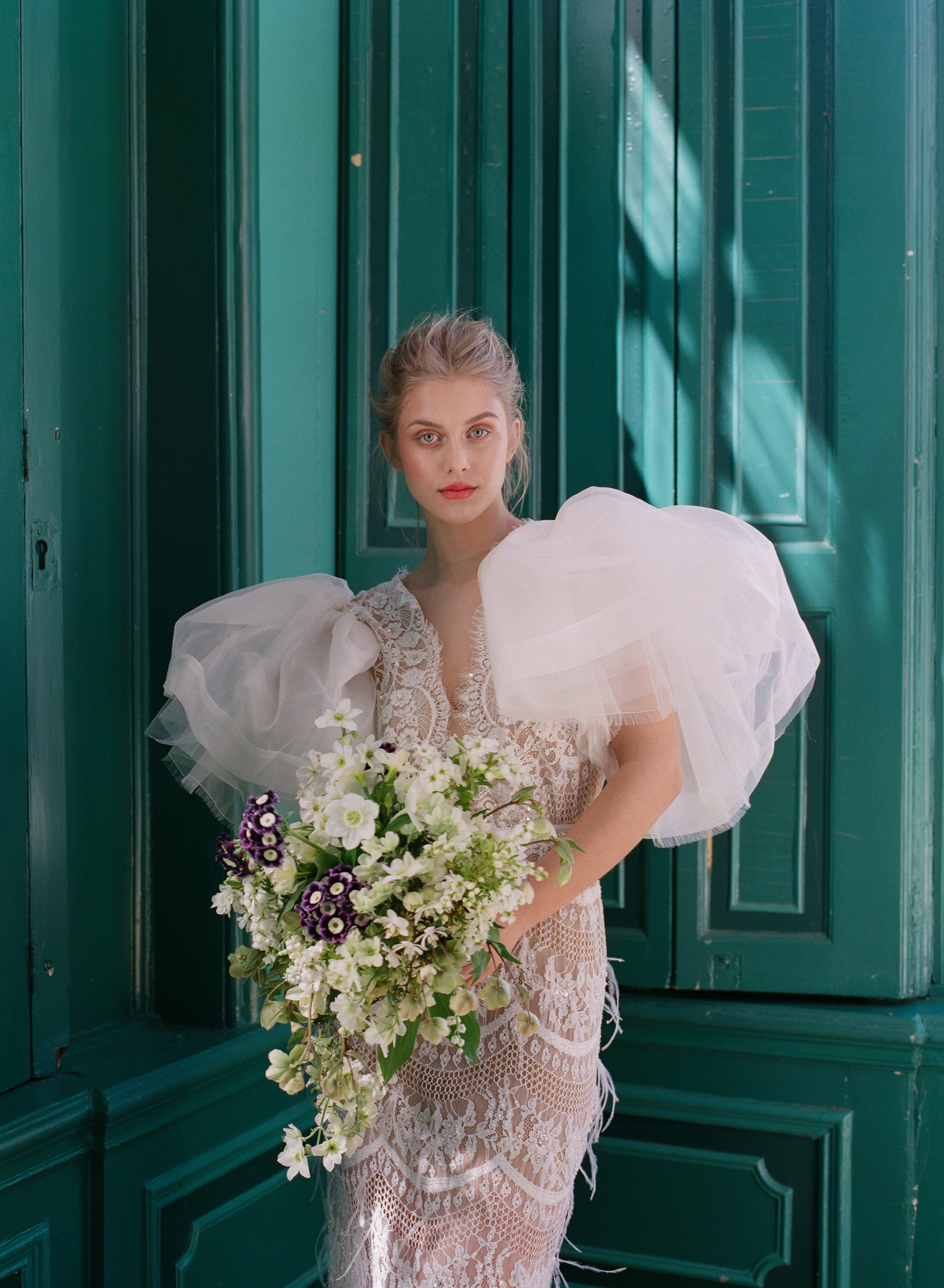 Bride in lace dress with large ruffled sleeves - photo by Corbin Gurkin