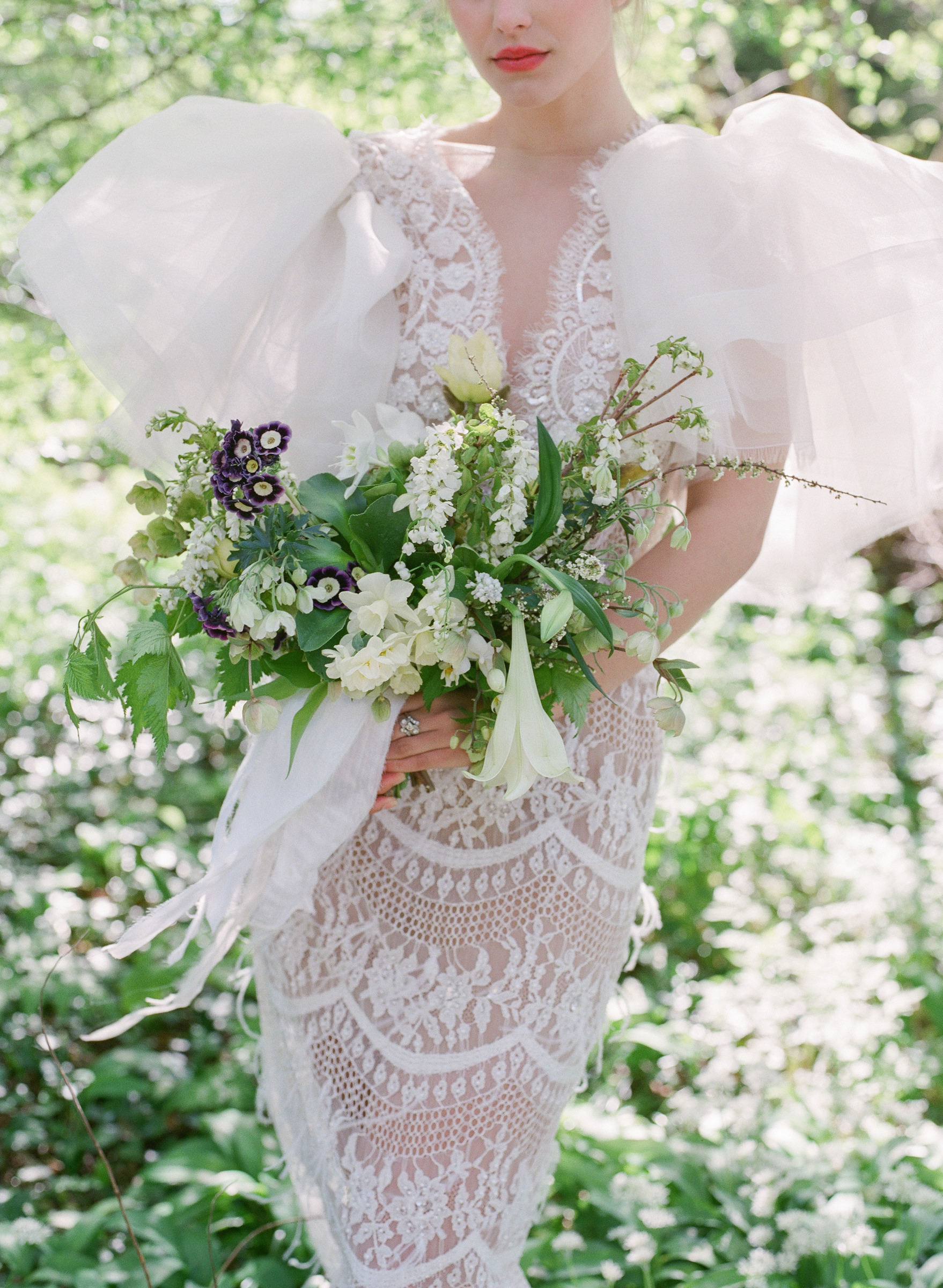 Bride with ballon sleeve lace gown and spring bouquet - photo by Corbin Gurkin