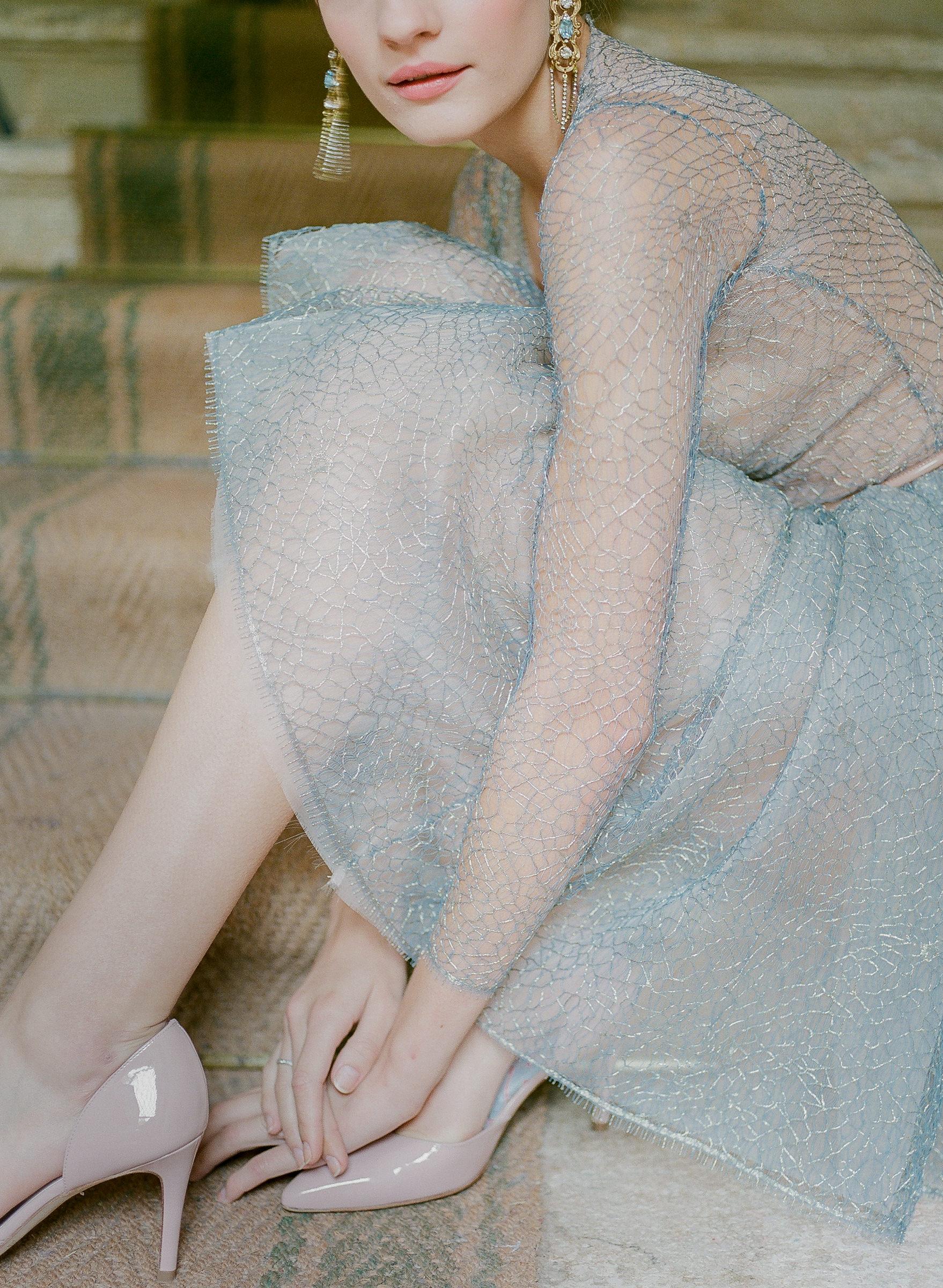 Light blue sheer wedding dress with short skirt  - photo by Corbin Gurkin