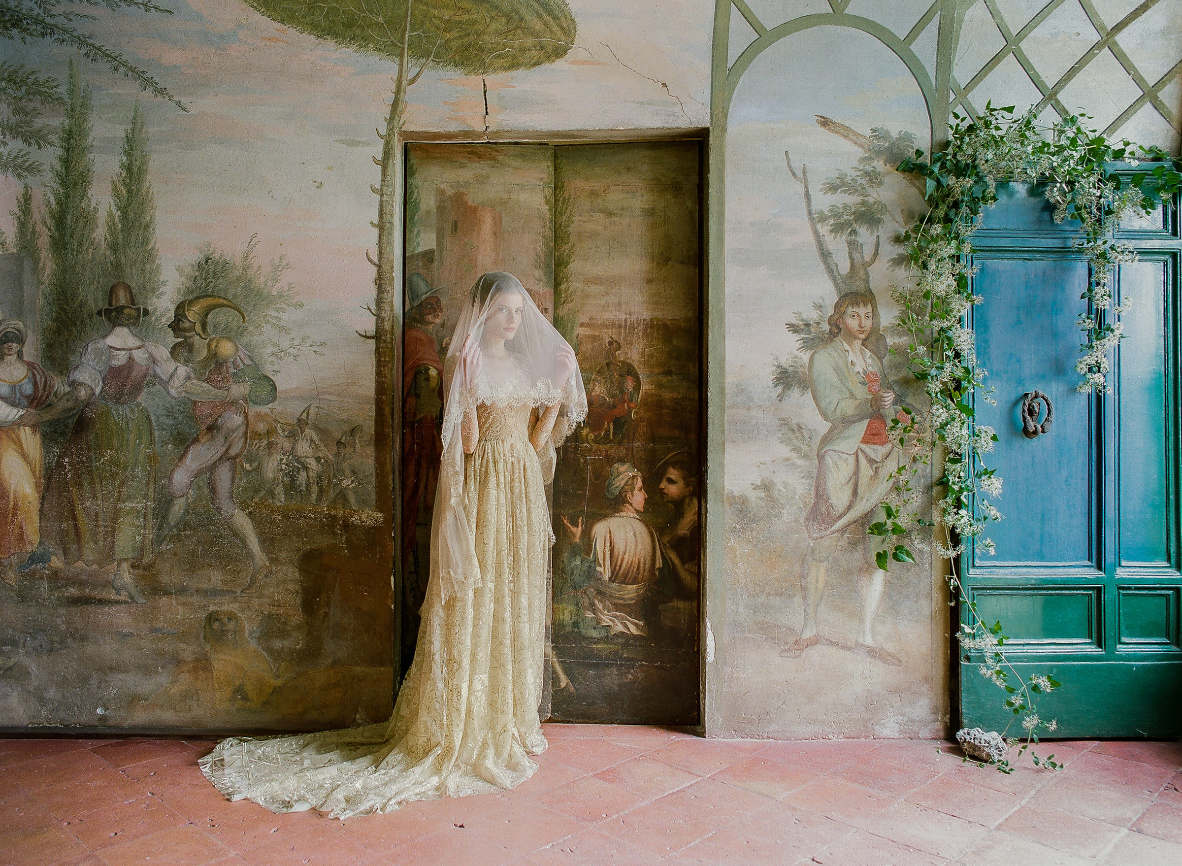 Bride in elegant metallic gown in painted room by Corbin Gurkin