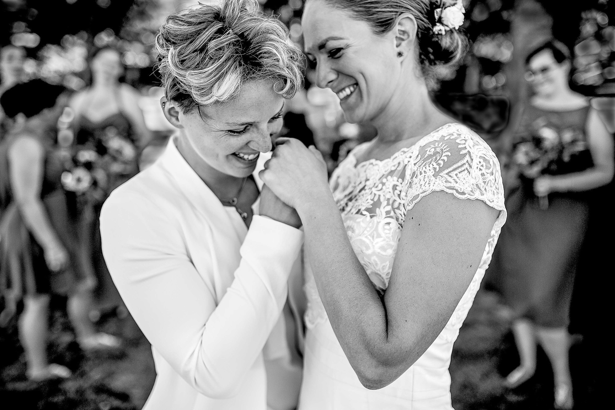 Brides hold hands after ceremony photo by JOS Studios : Jos and Tree Woodsmith
