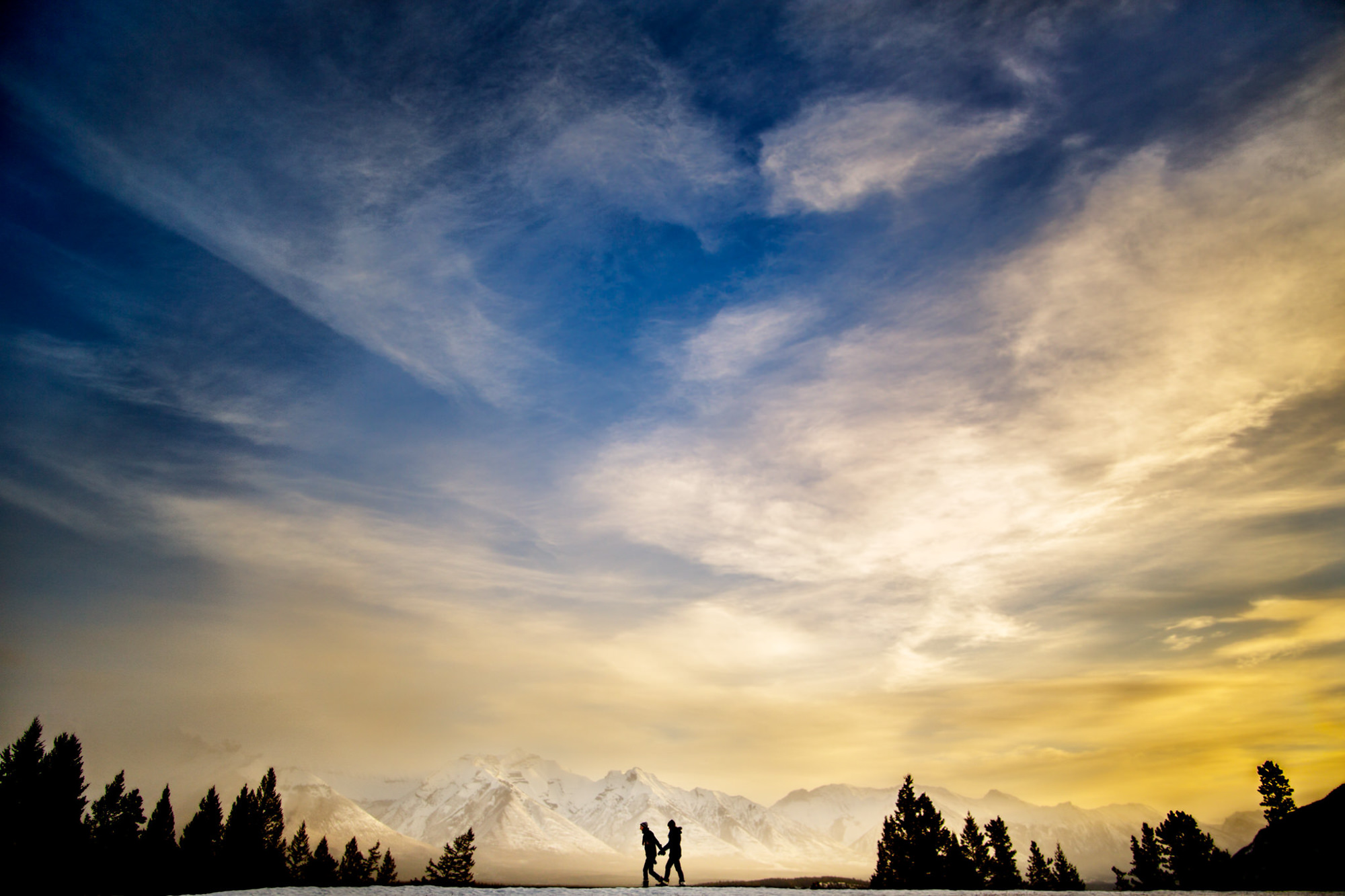 Canadian rockies silhouette of couple - photo by Two Mann Studios