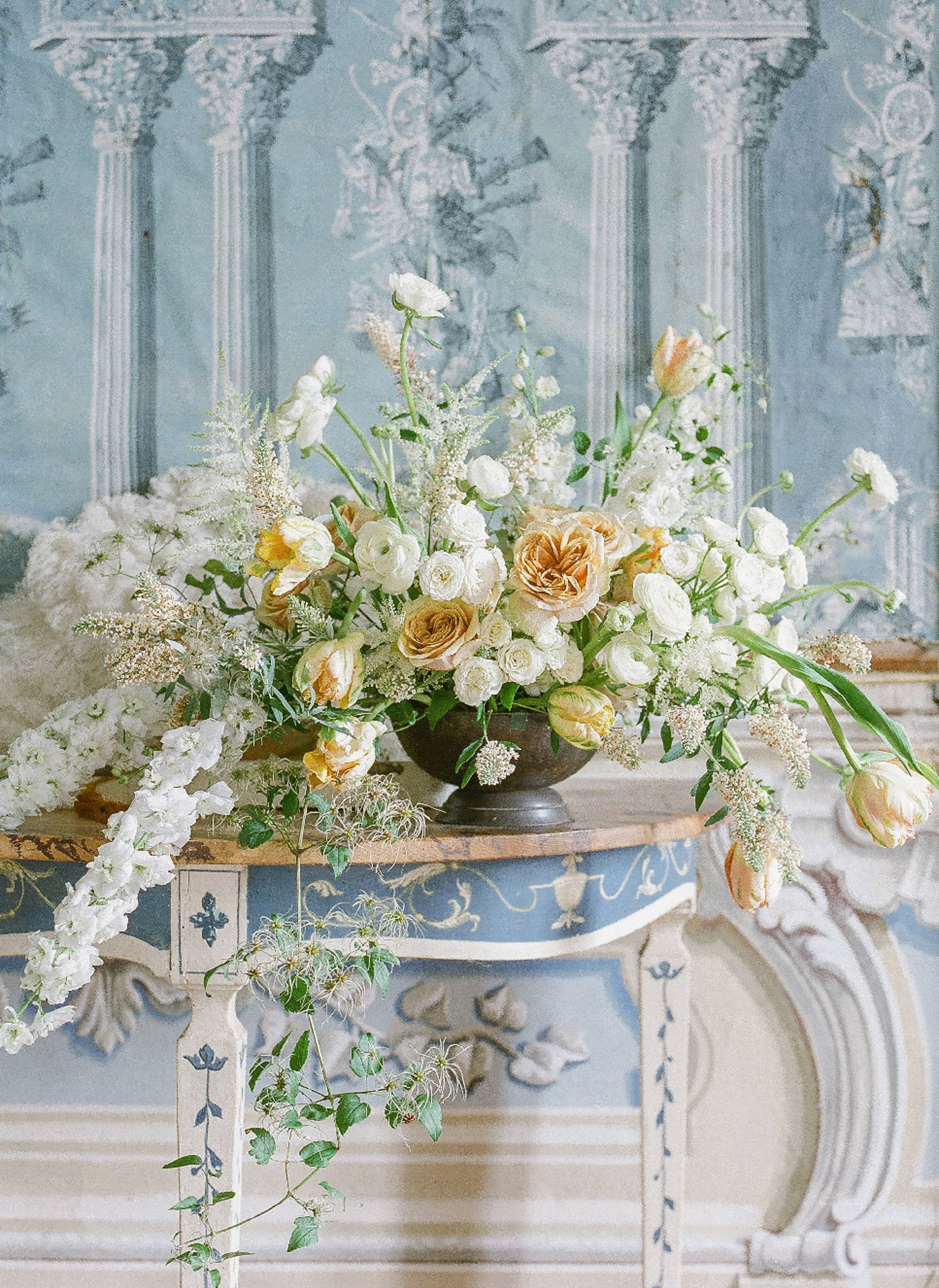White and cream summer centerpiece with delphinium and roses - photo by Corbin Gurkin