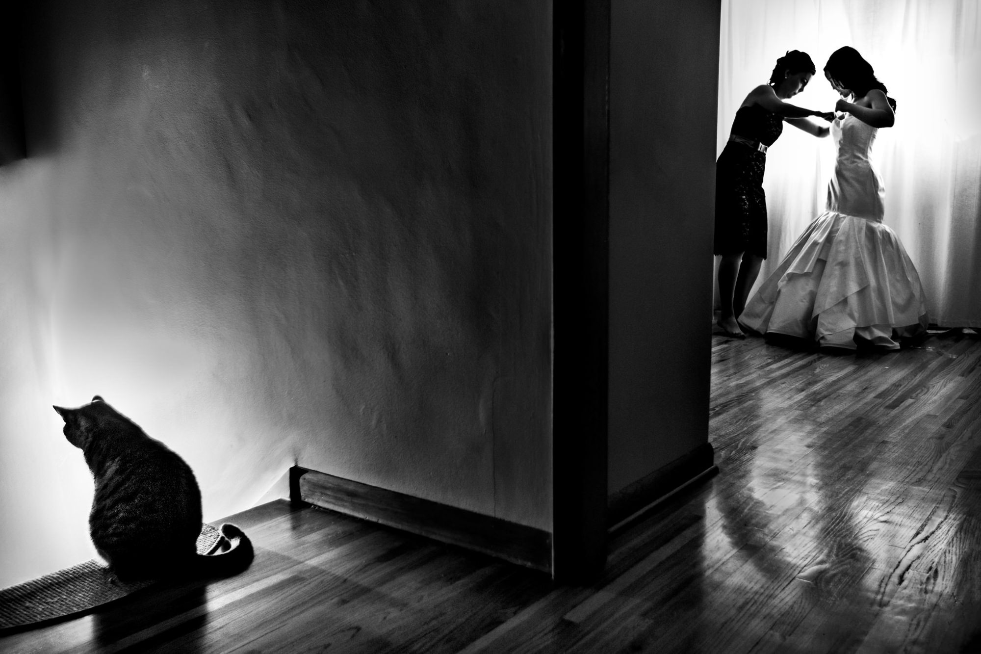 Bride gets ready while cat waits - photo by Two Mann Studios