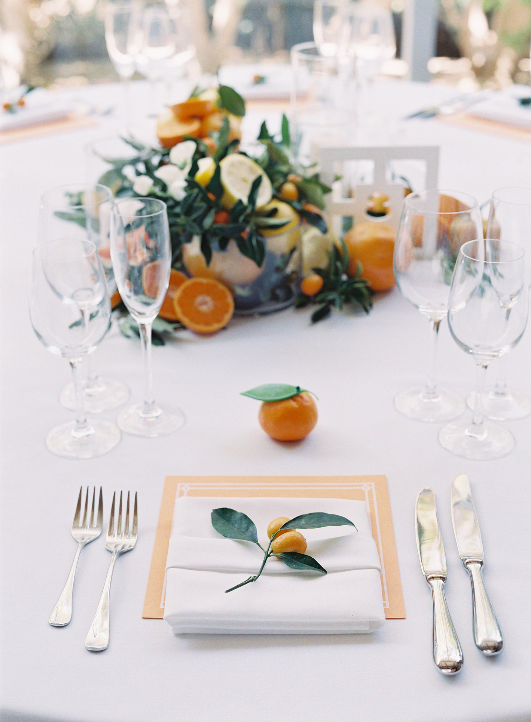 Citrus and kumquat place settings and centerpieces - photo by Corbin Gurkin