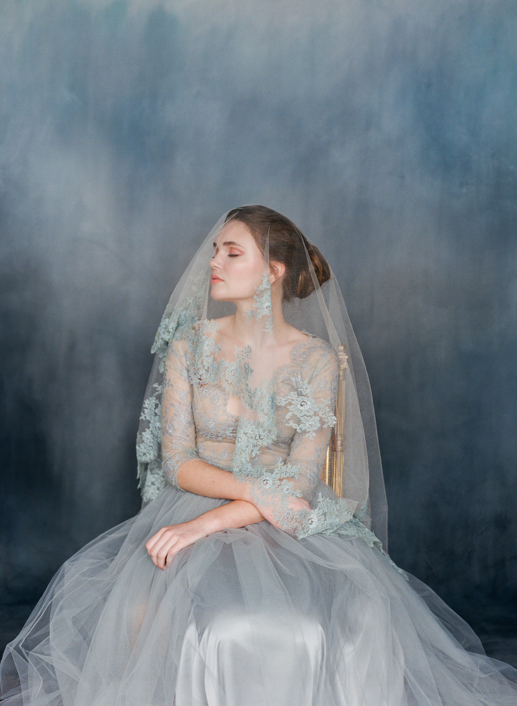 Classic portrait of bride in pewter mantilla veil and gown  - photo by Corbin Gurkin