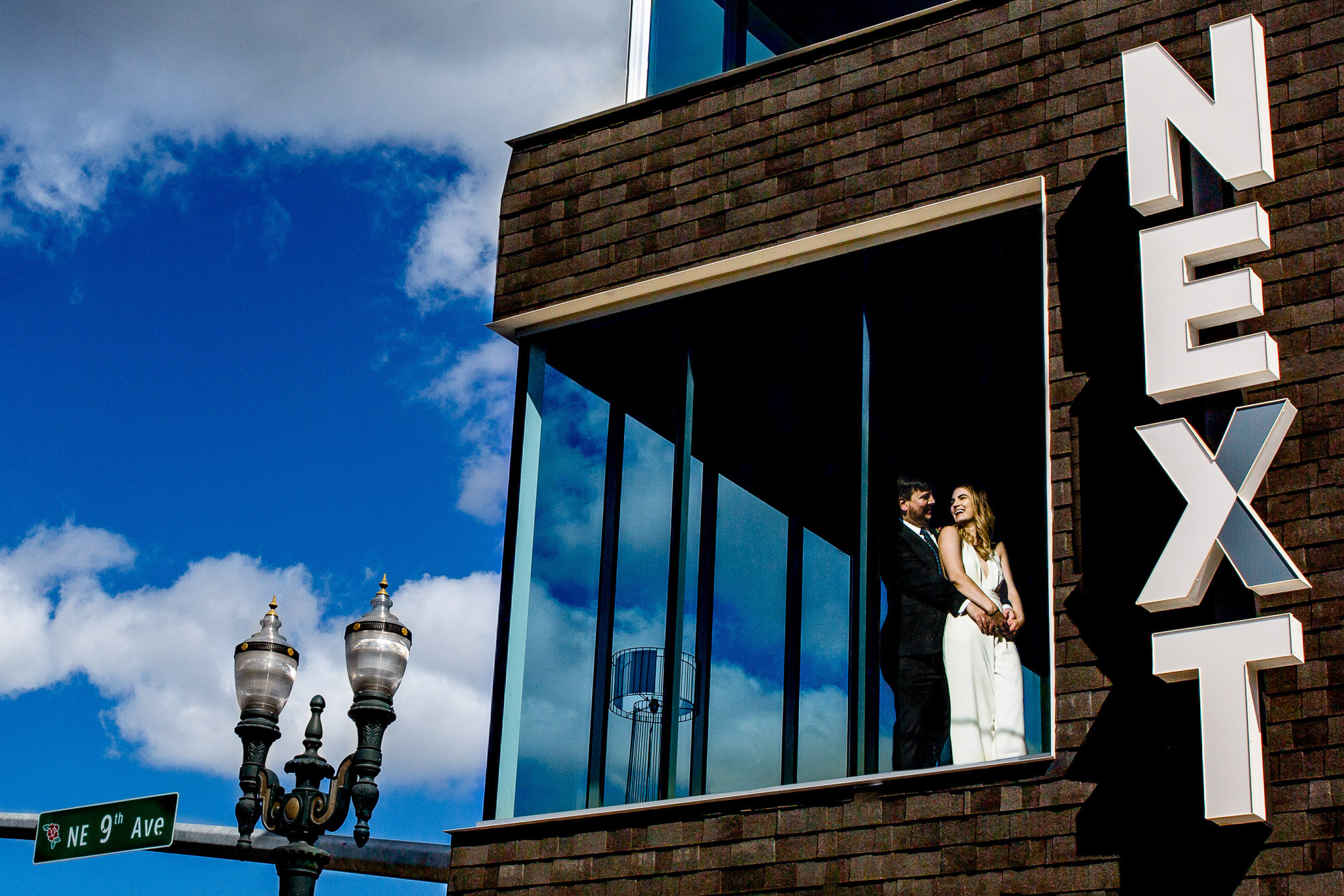 Couple in window of Next Hotel photo by JOS Studios : Jos and Tree Woodsmith