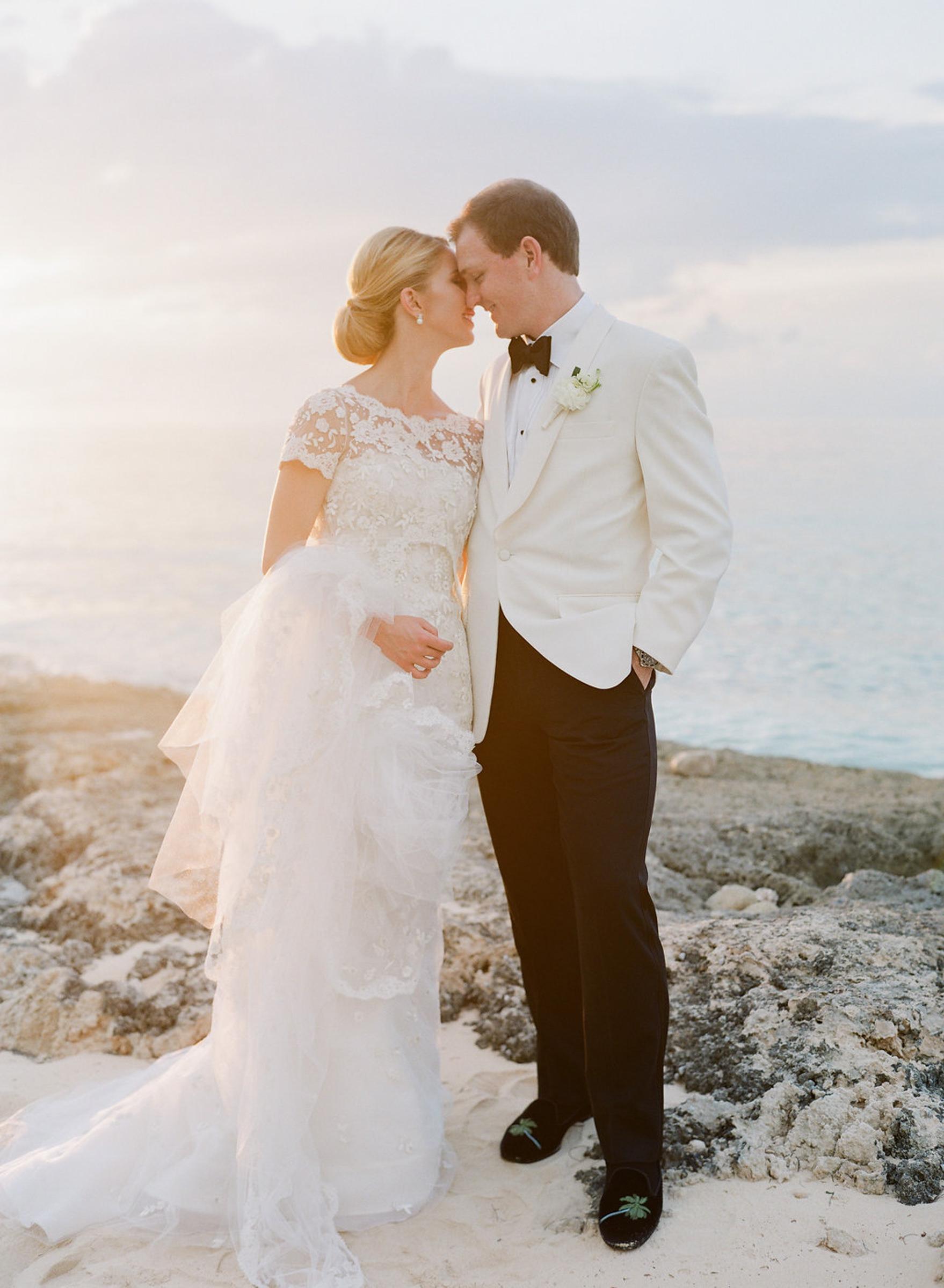 Romamtic portrait of bride and groom wearing white tuxedo by Corbin Gurkin