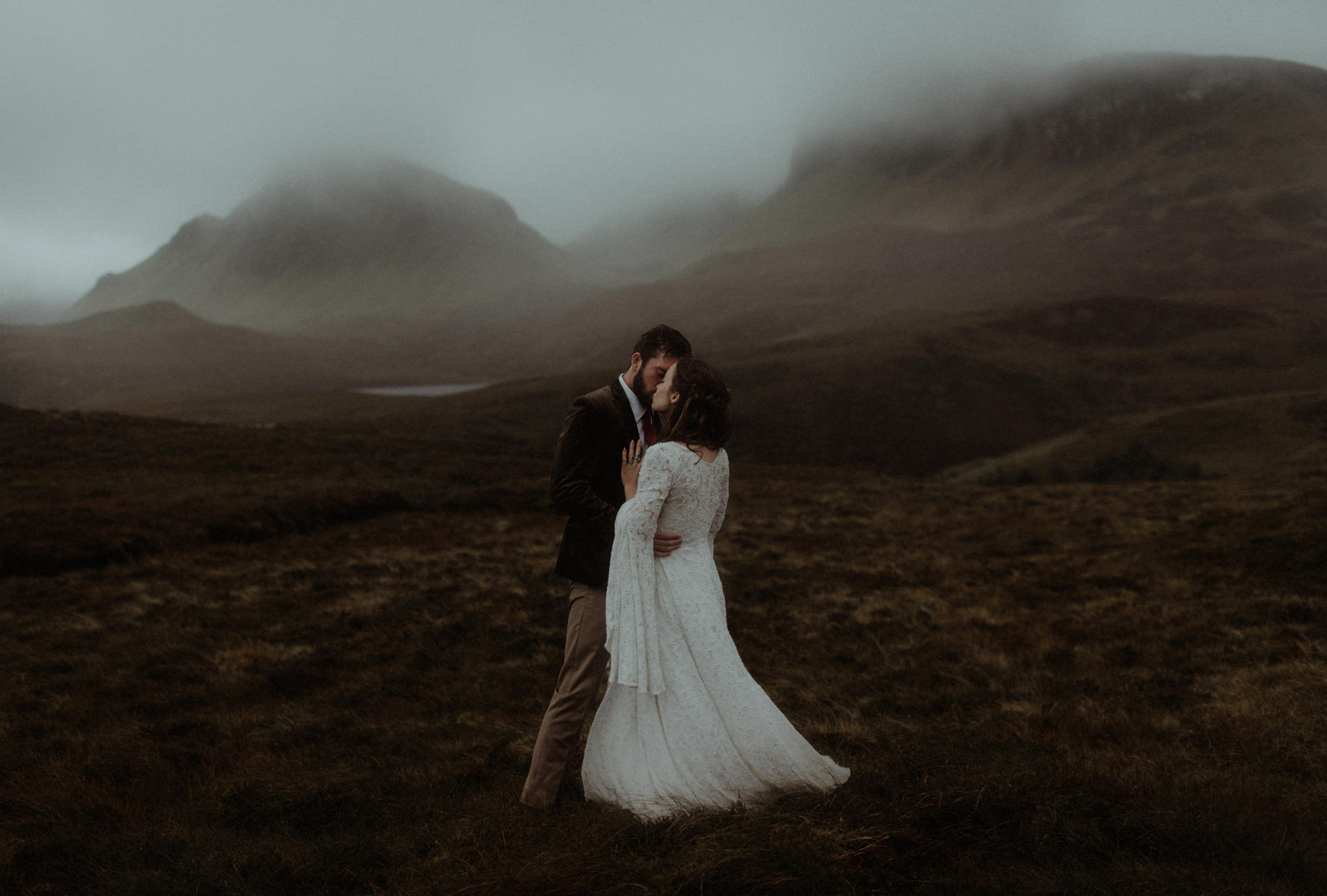 Romantic portrait of couple kissing on the moors by The Kitcheners