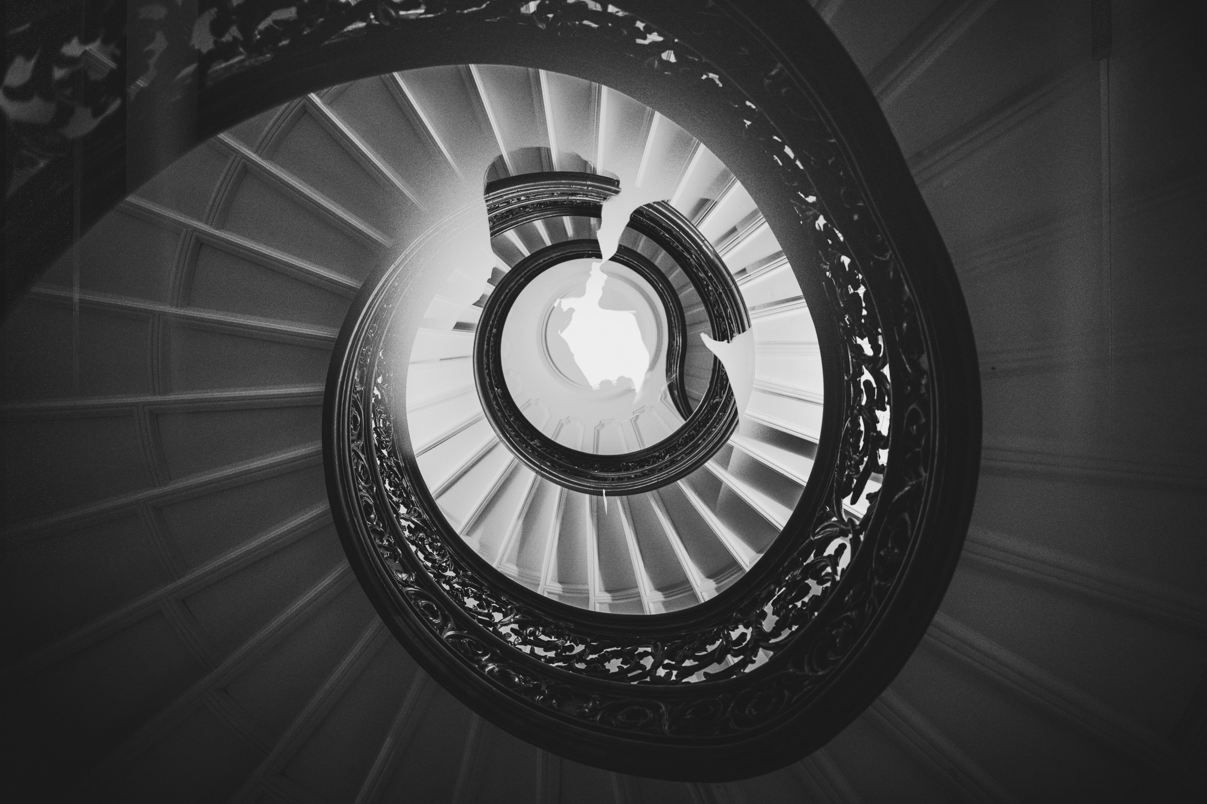 Multiple exposure couple silhouette on circular stairway by Sam Hurd - DC