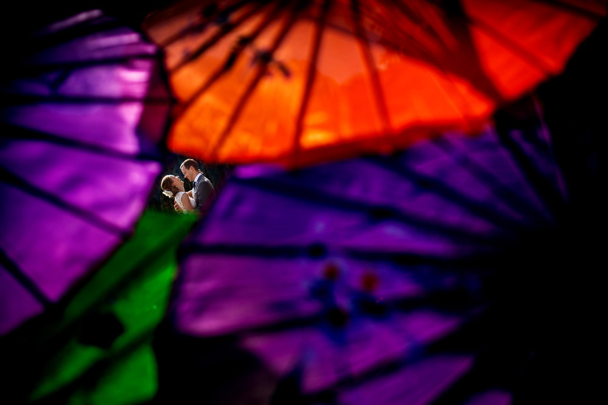 Couple through colorful umbrellas - photo by Two Mann Studios