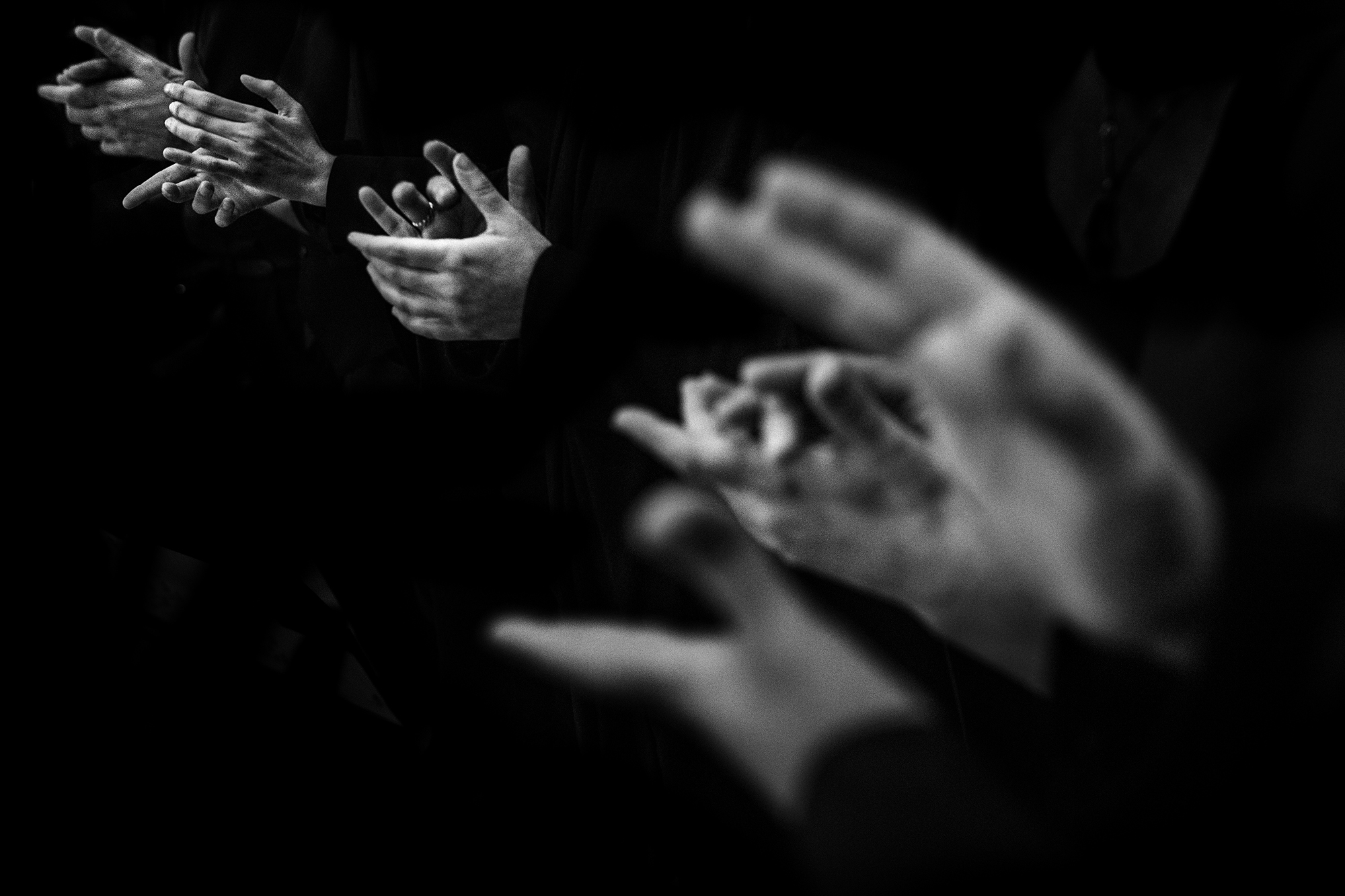 Hands clapping - photo by Victor Lax