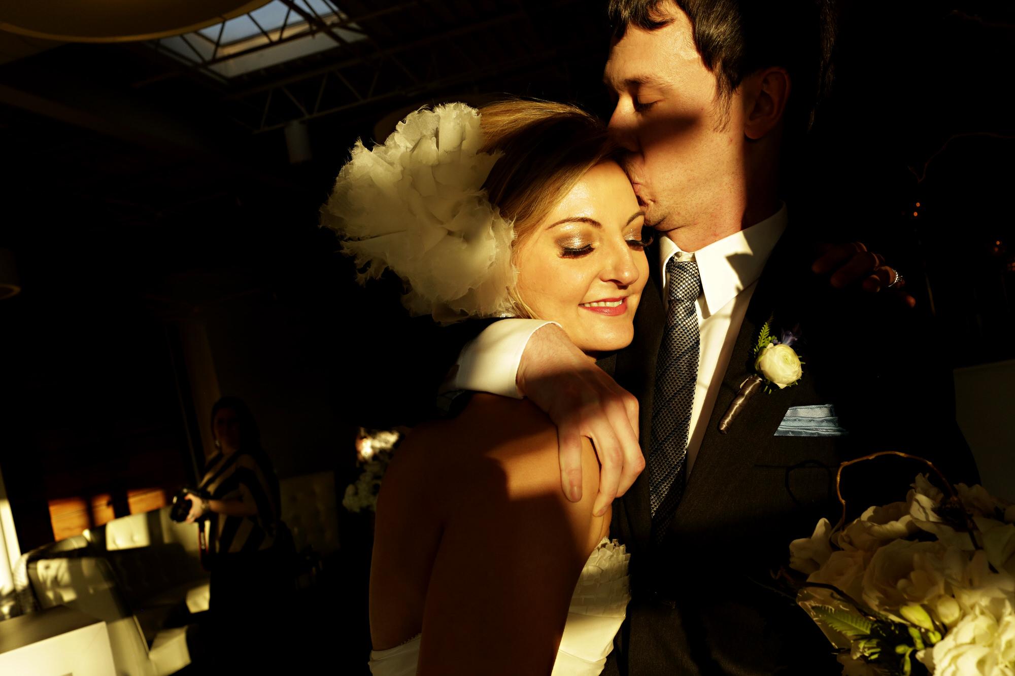 Dappled light photo of bride and groom by Tyler Wirken - Kansas City