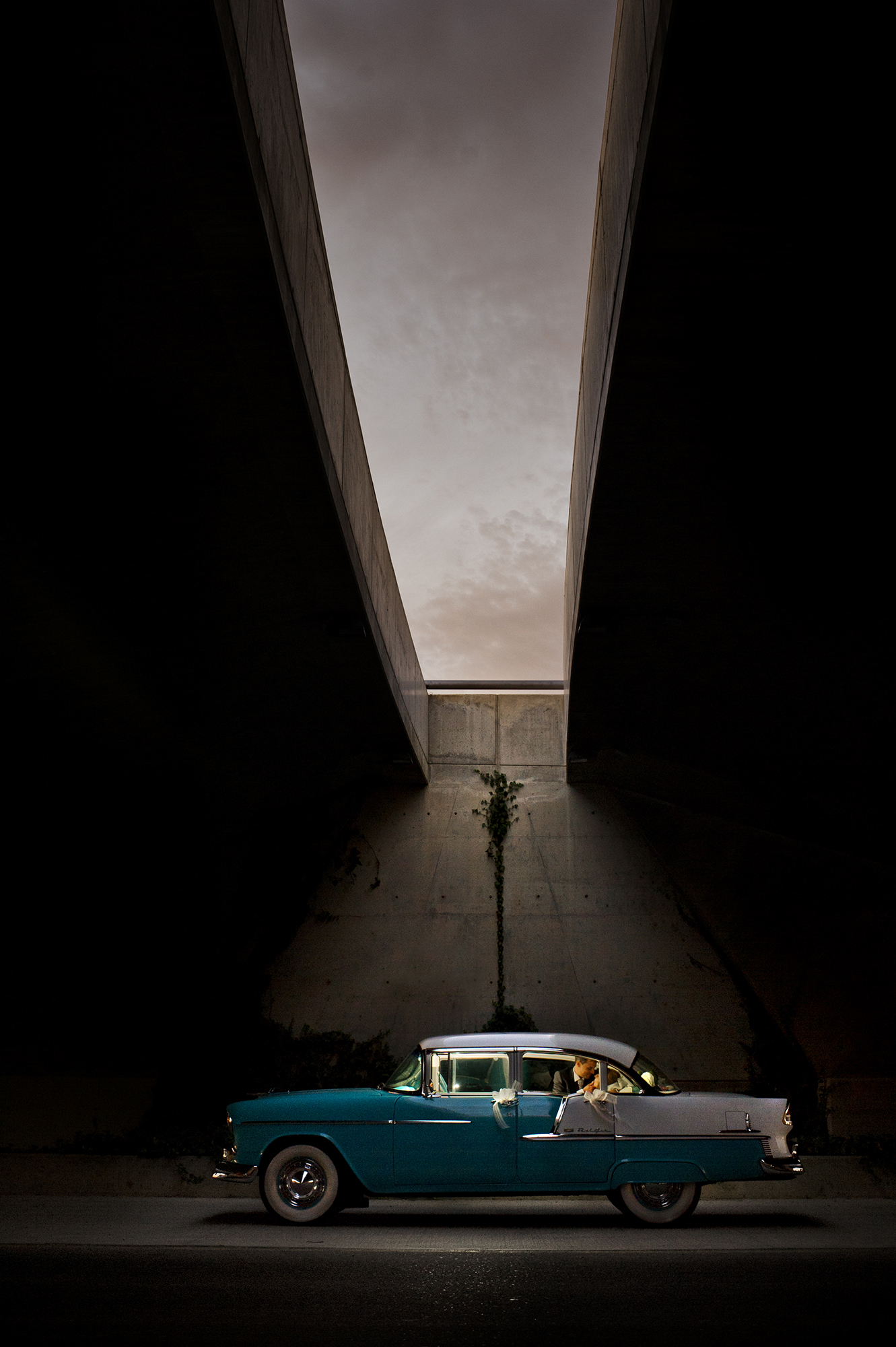 Couple in limo under skylight - photo by Victor Lax