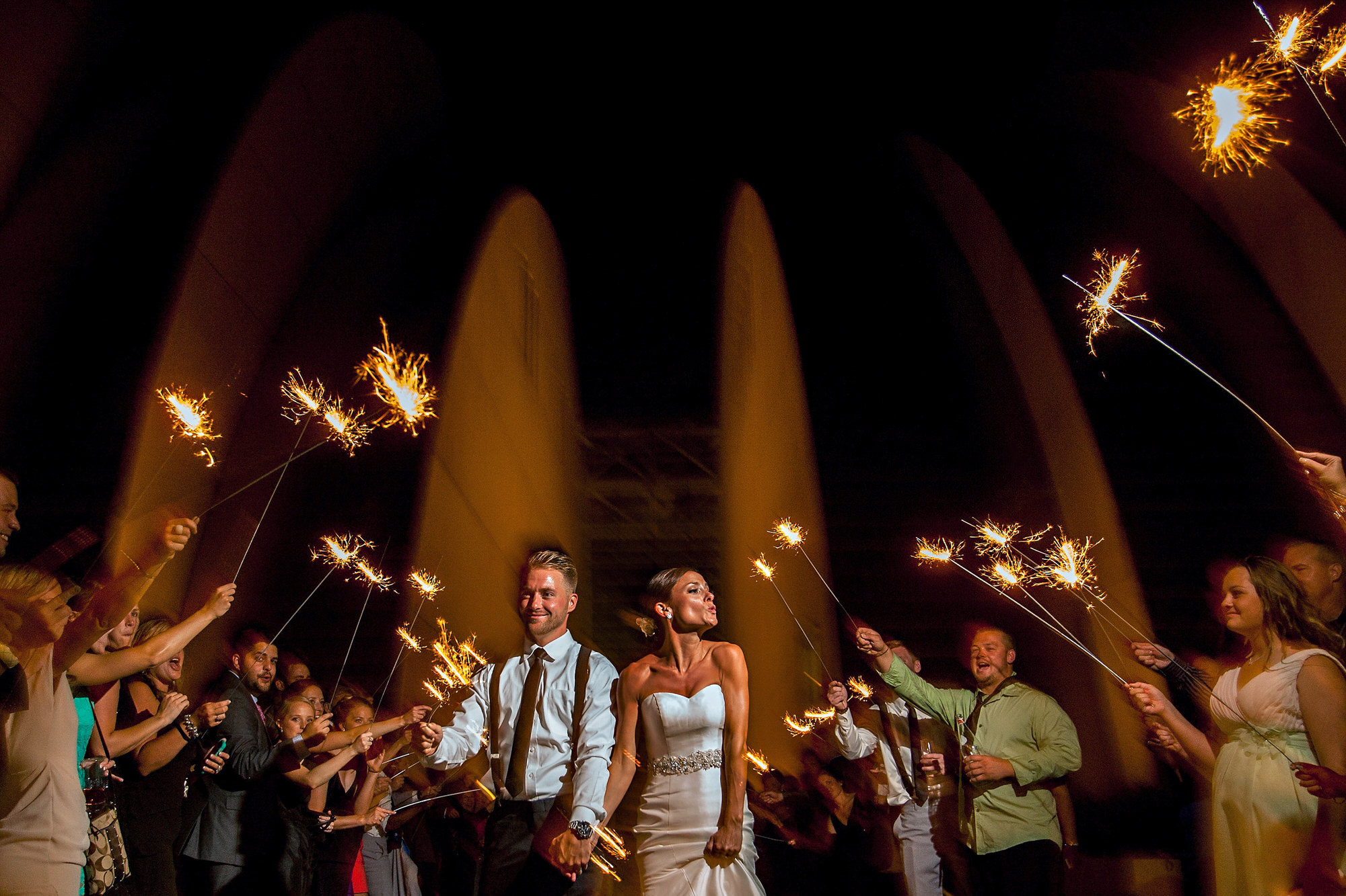 Bride and room exit ceremony with sparklers - photo by Tyler Wirken