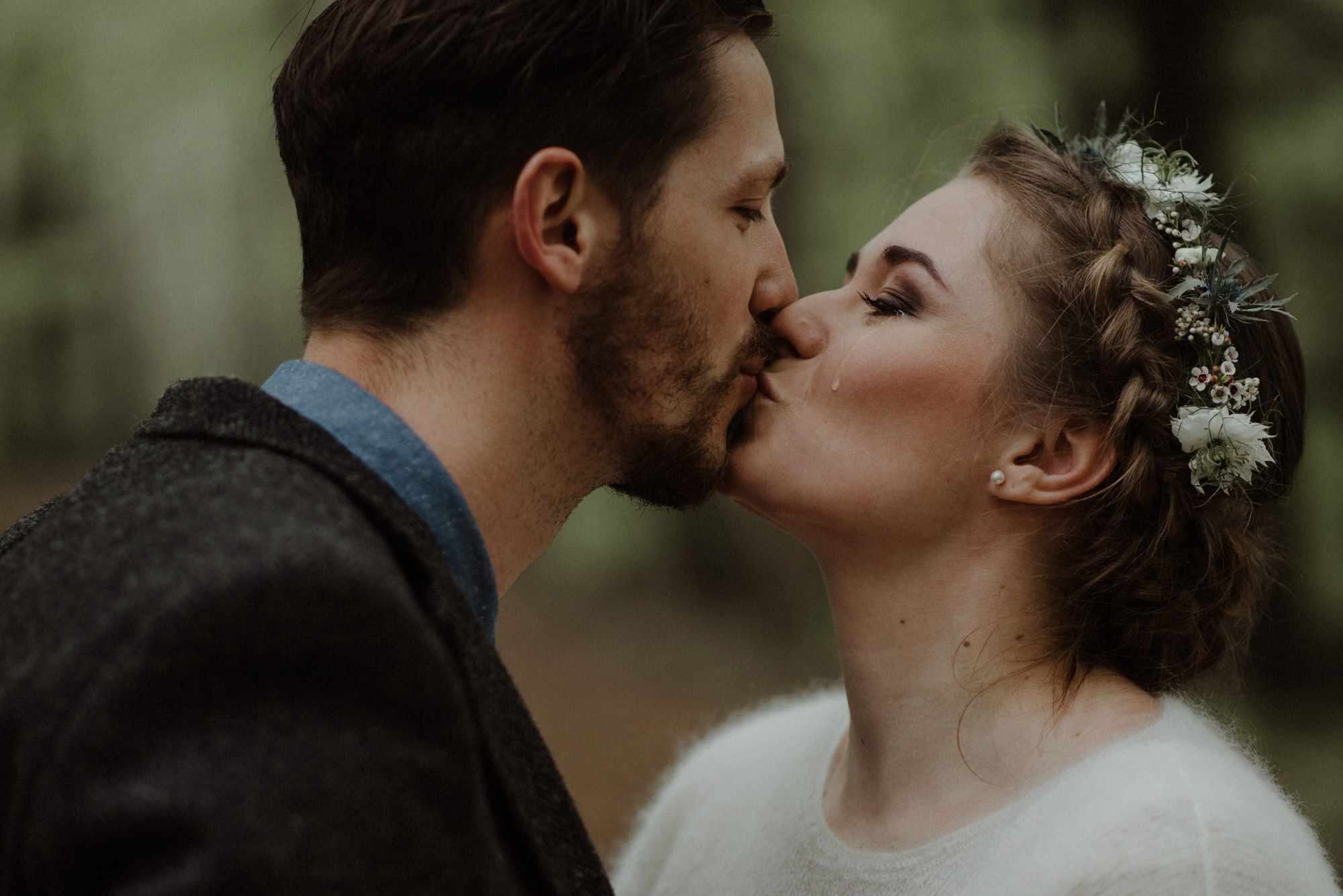 Bride with tear on her cheek kisses groom - photo by the Kitcheners - Scotland